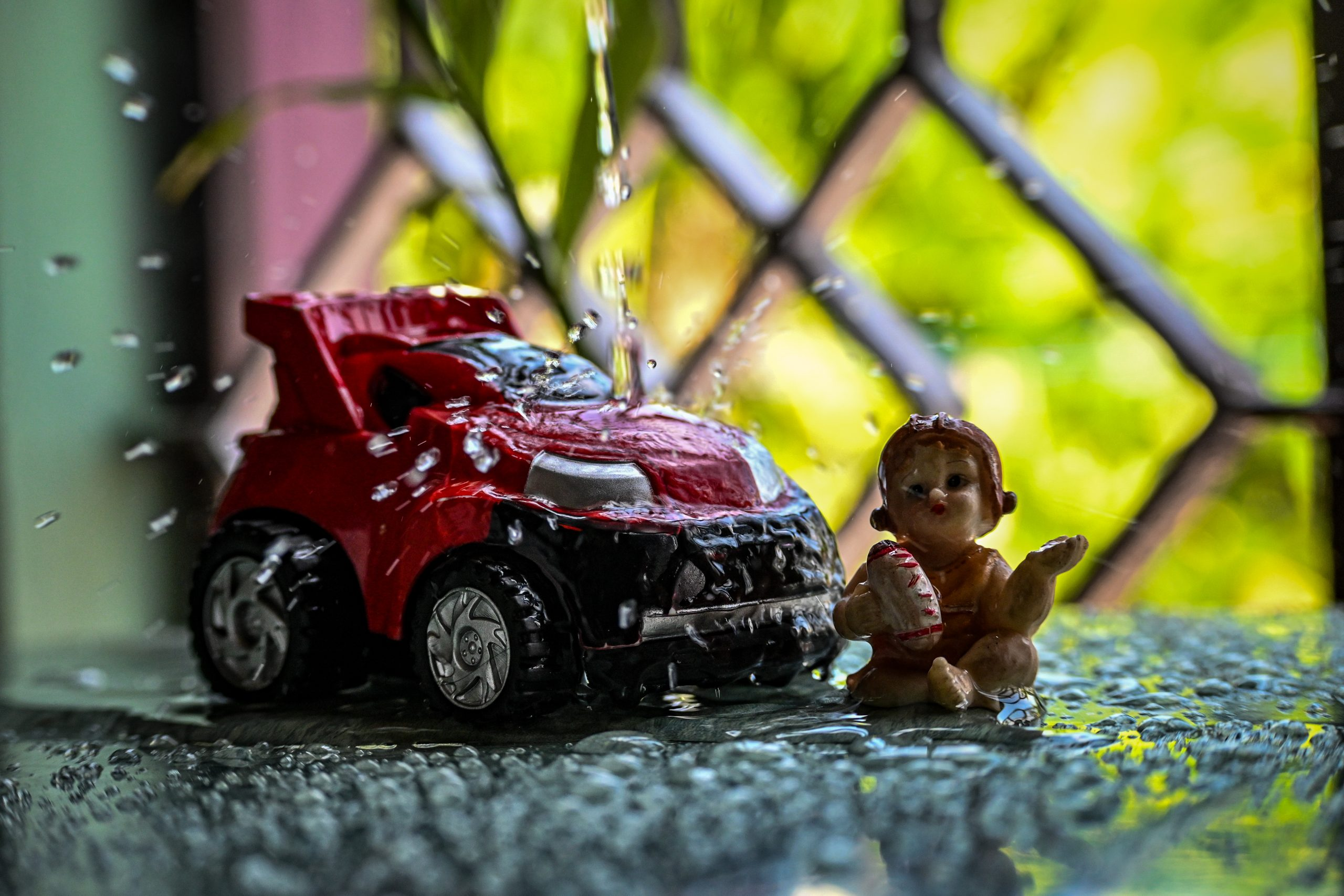 water falling over Toy car