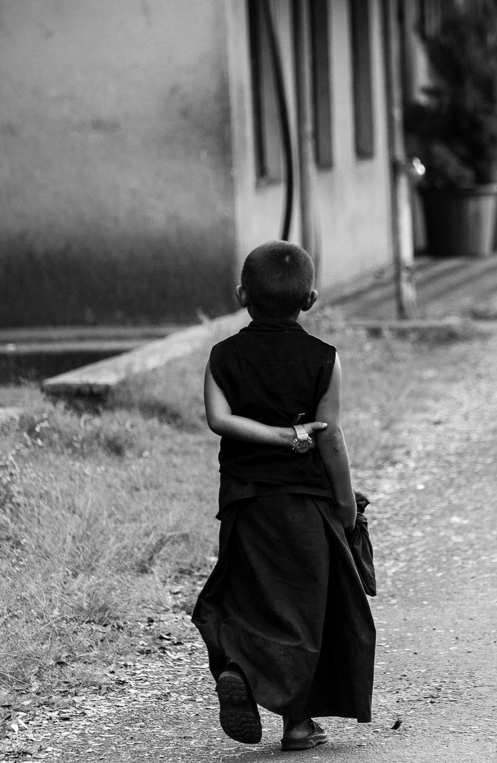 A Buddhist monk walking