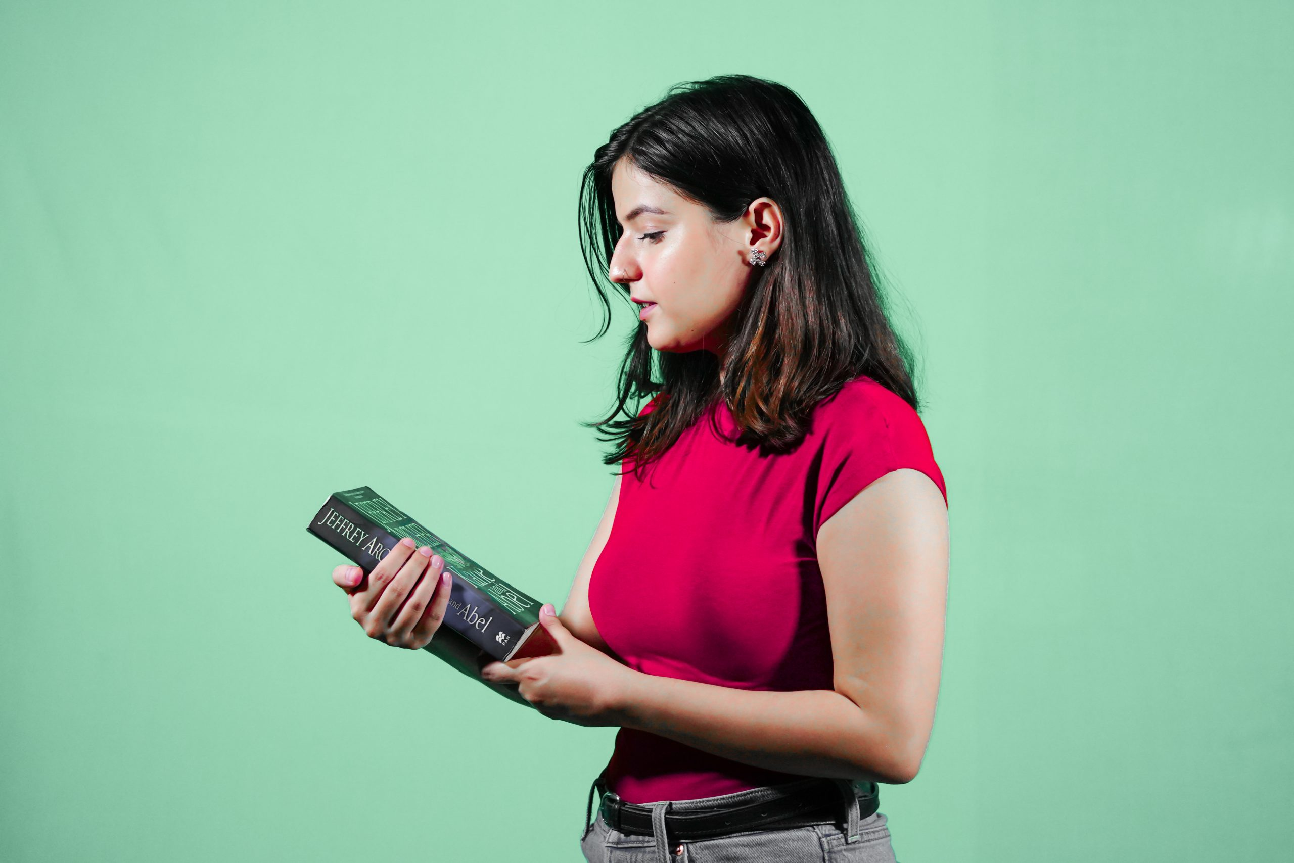A Girl looking at Book