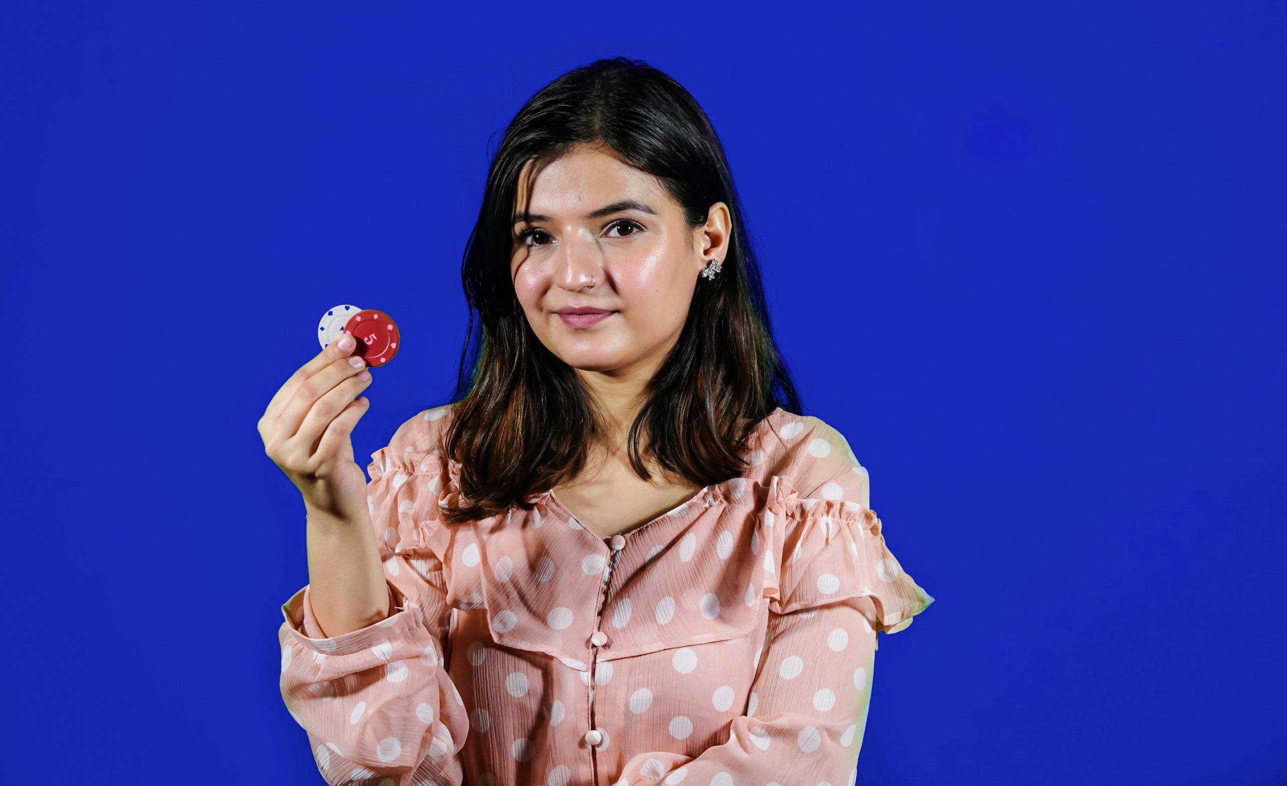 girl holding poker chips