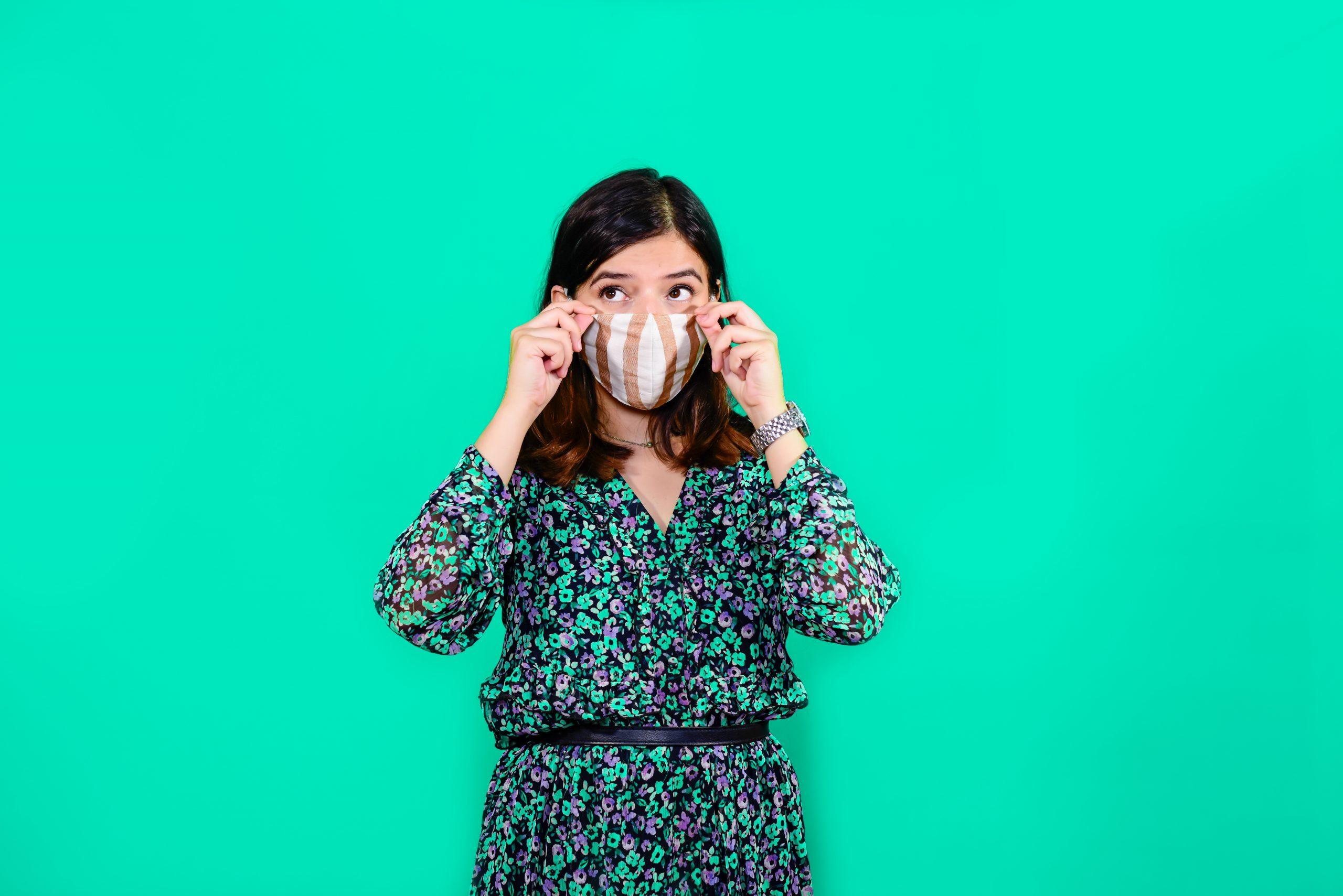 Girl wearing mask to avoid virus