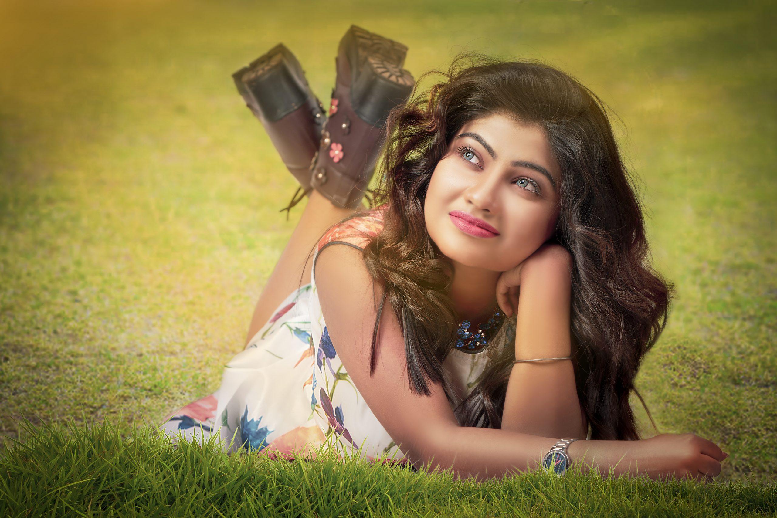 A beautiful girl laying on grass
