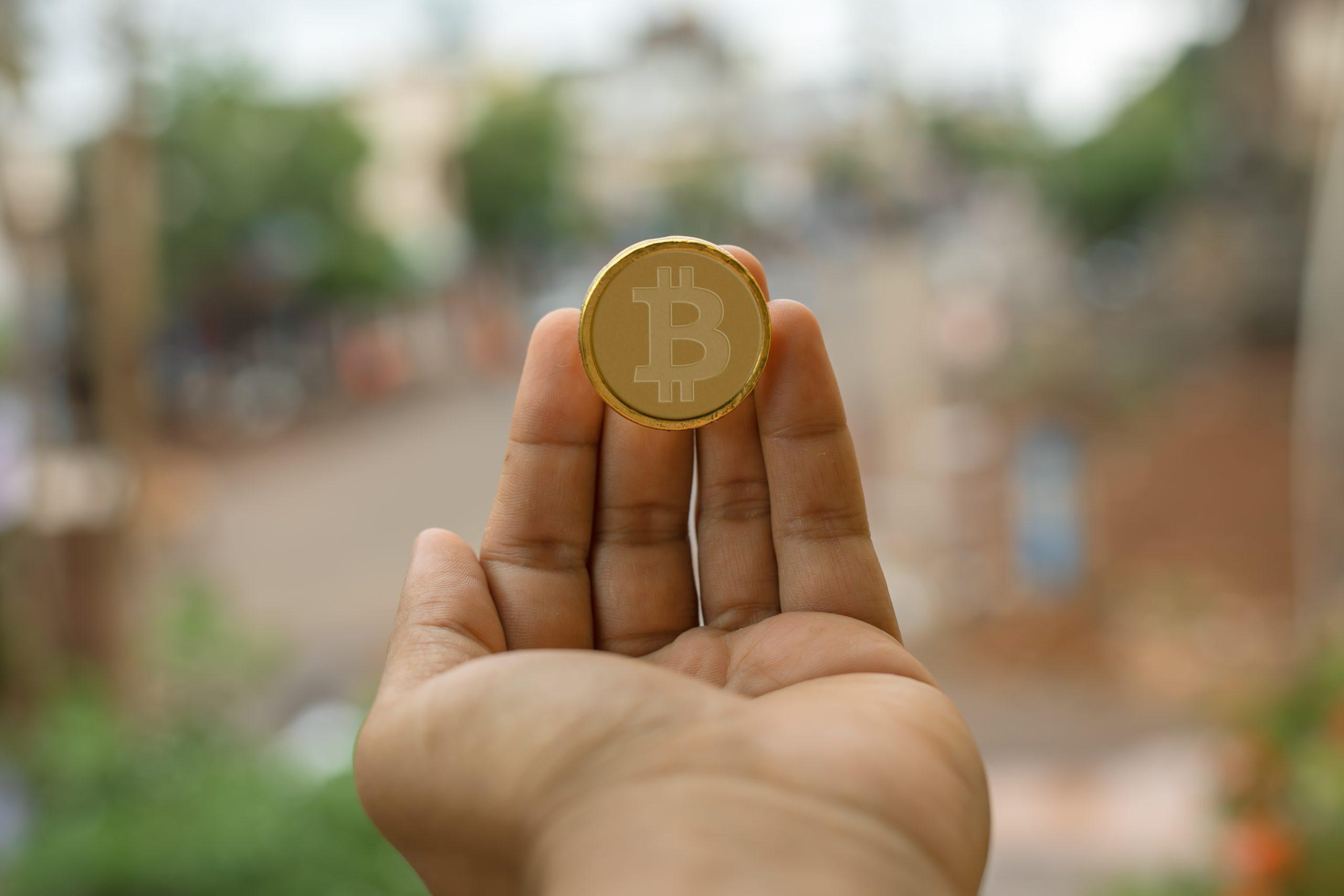 A bitcoin in hand