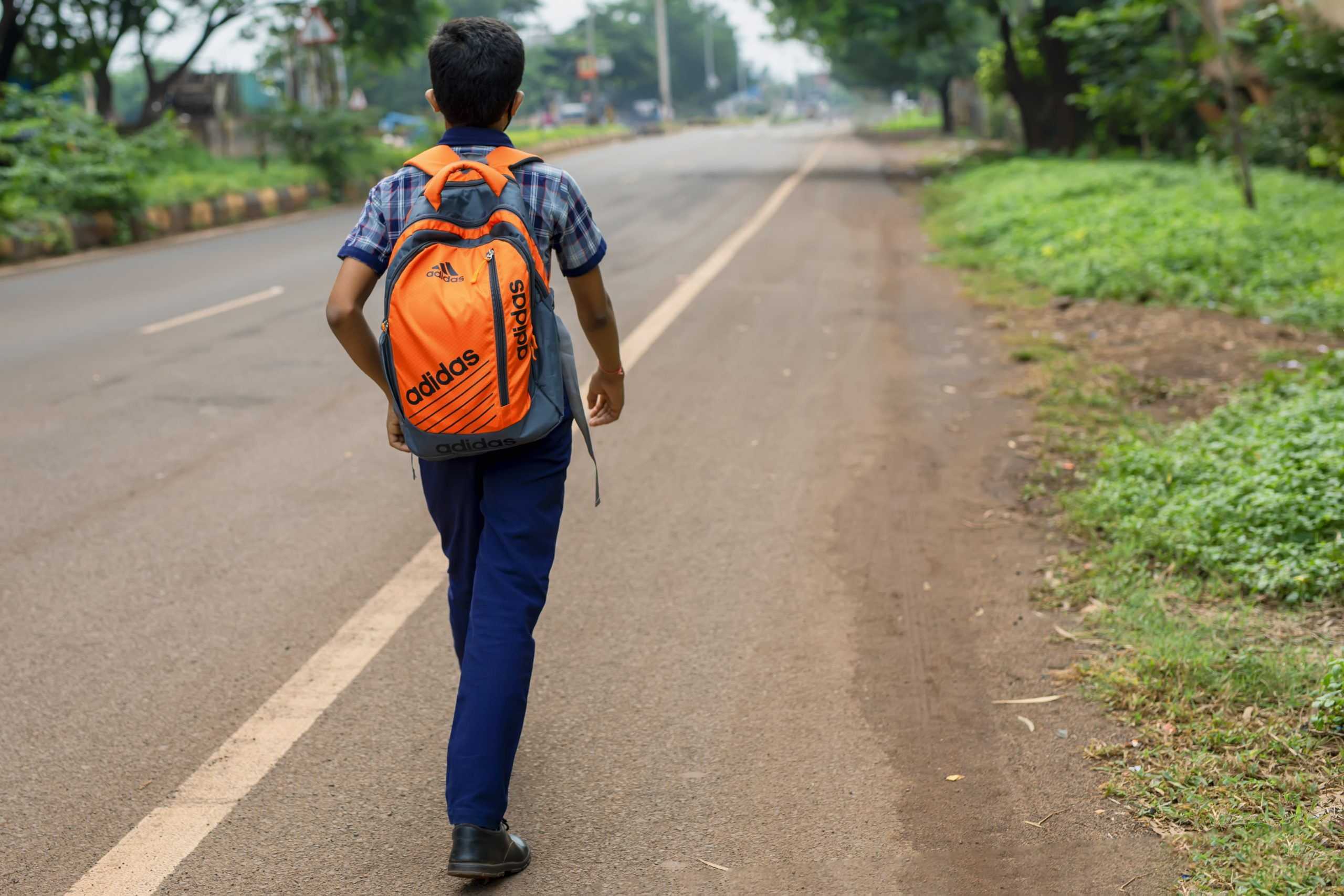 Boy walking on road