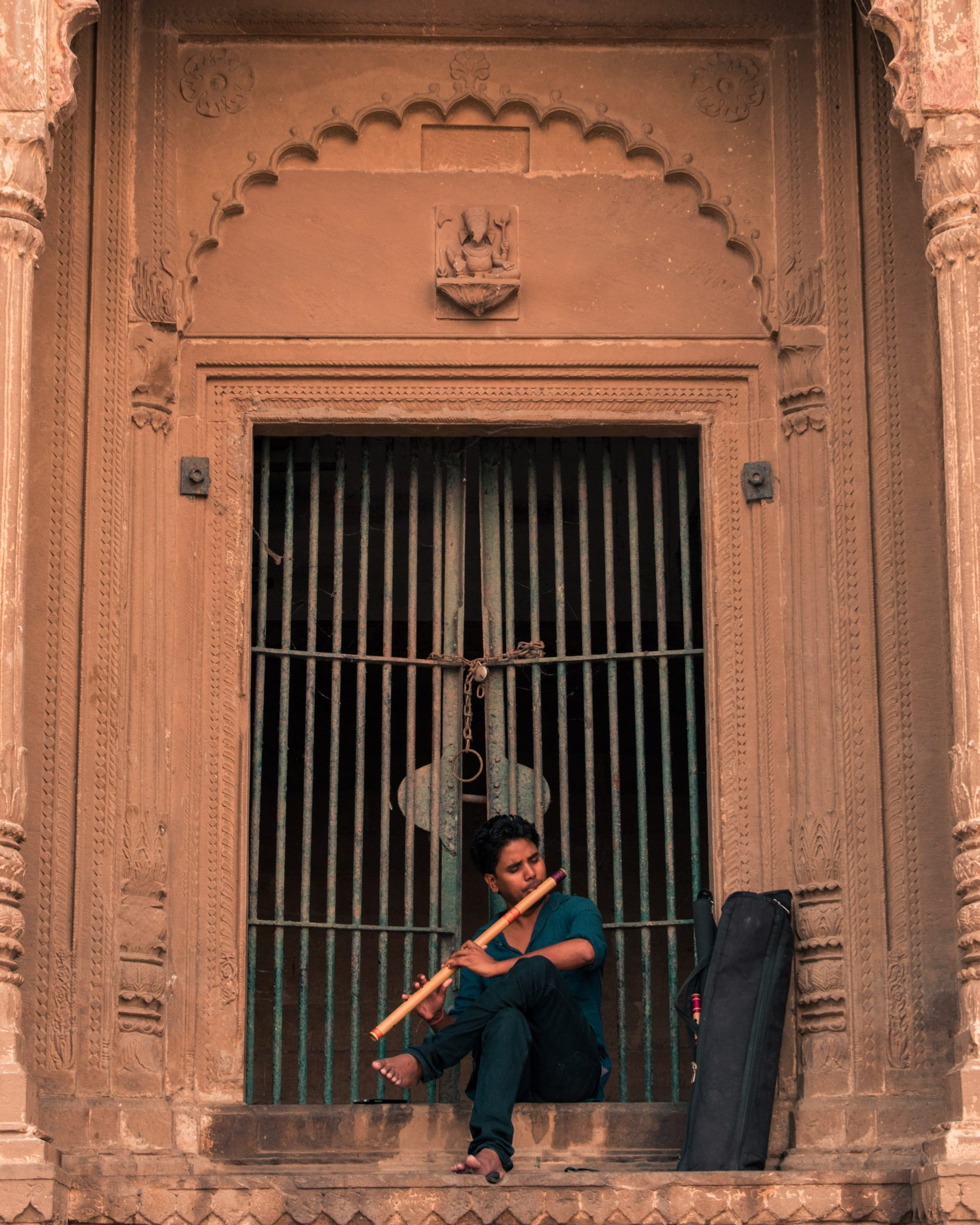 A boy blowing flute in a temple
