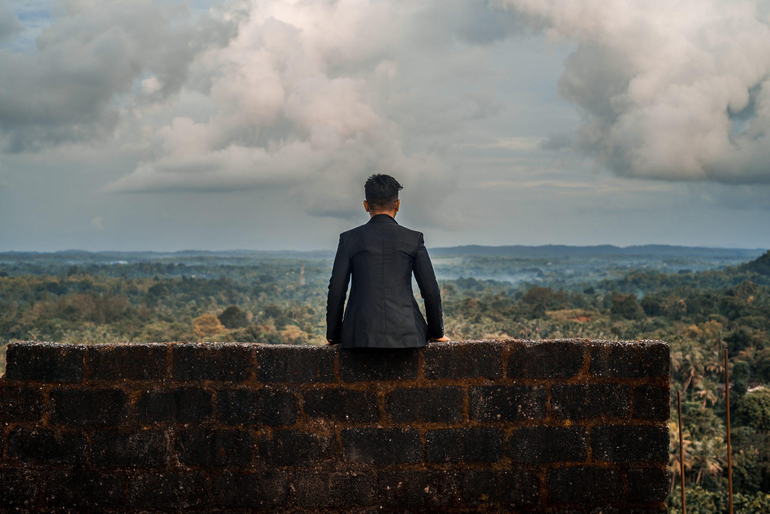 A boy sit on a top
