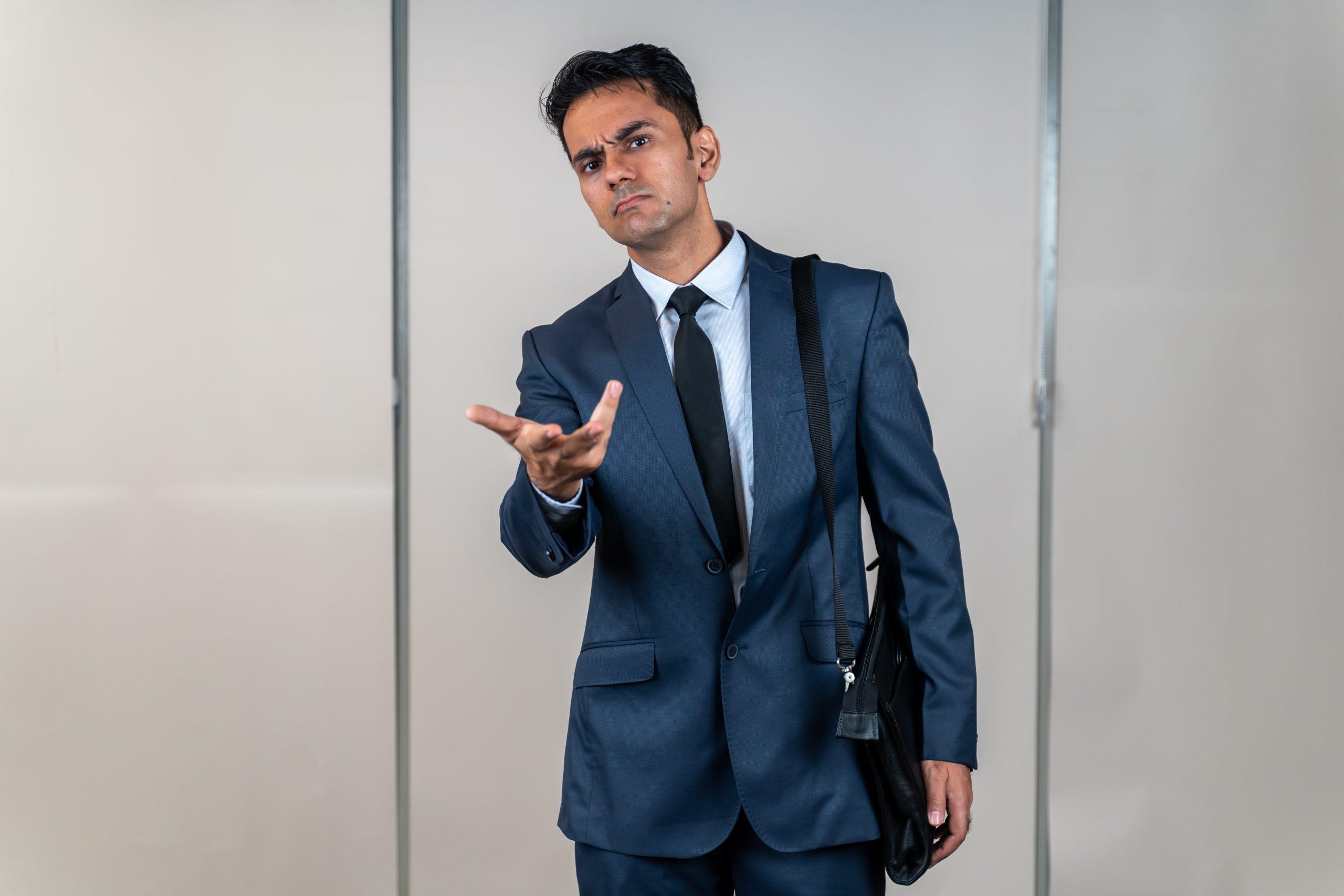 A businessman asking something