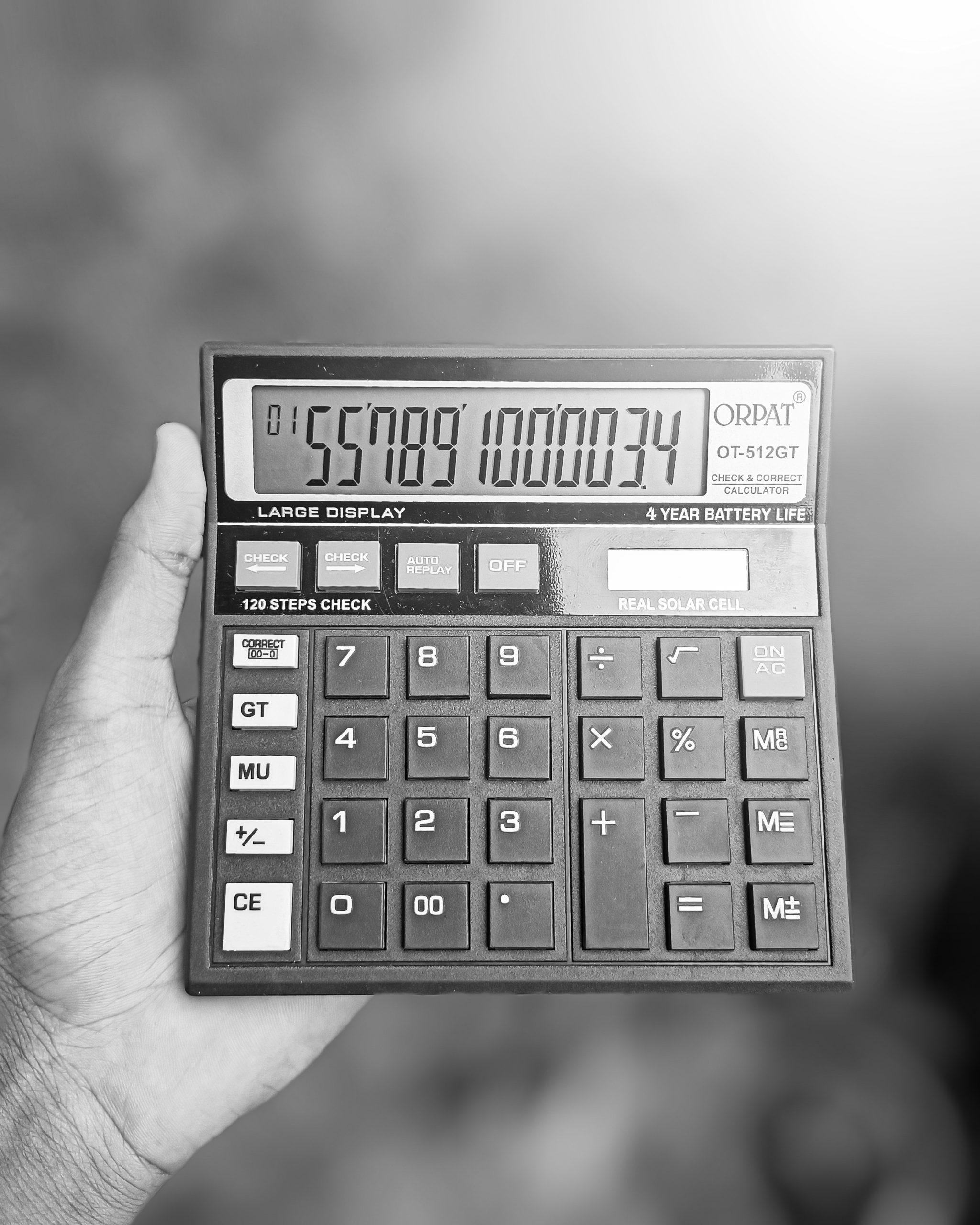 A calculator in hand