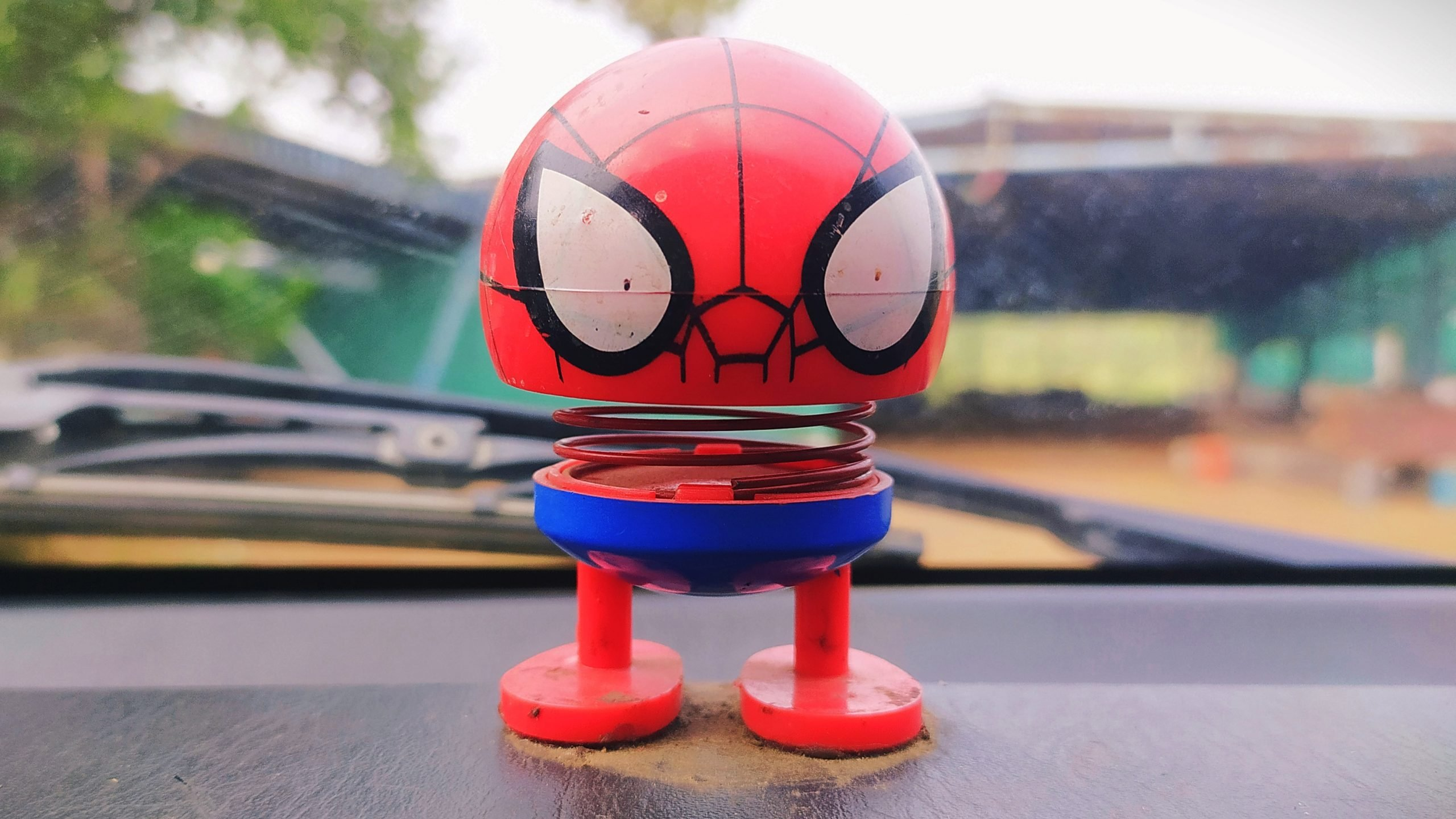 A cartoon toy on a car dashboard