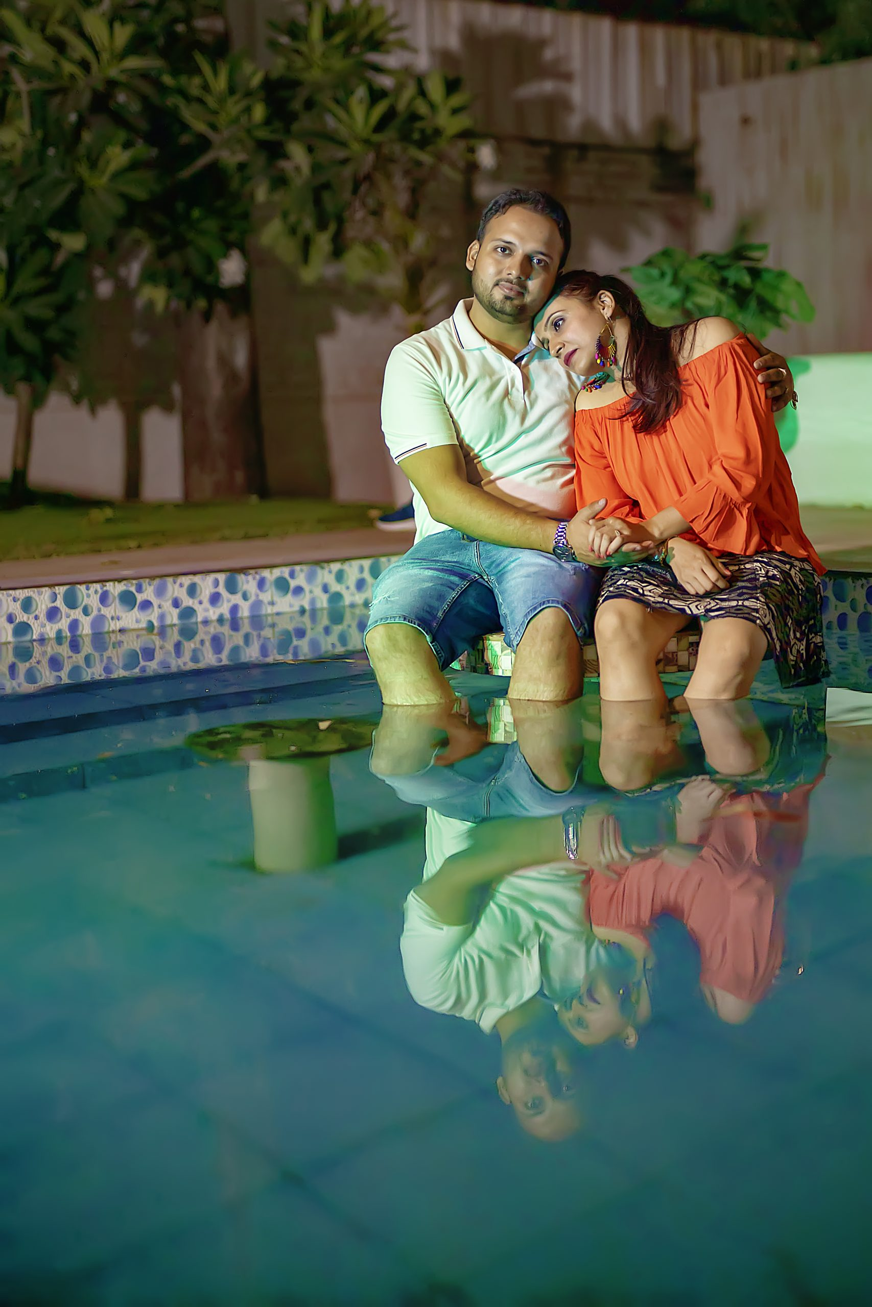 A couple romancing in pool