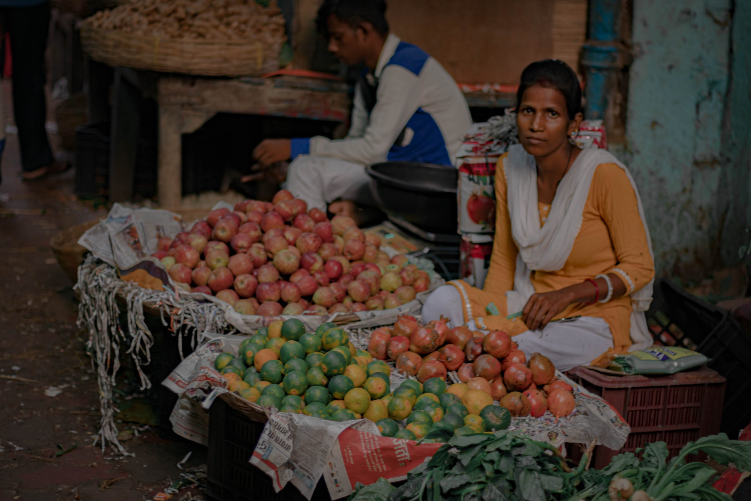A couple selling fruits