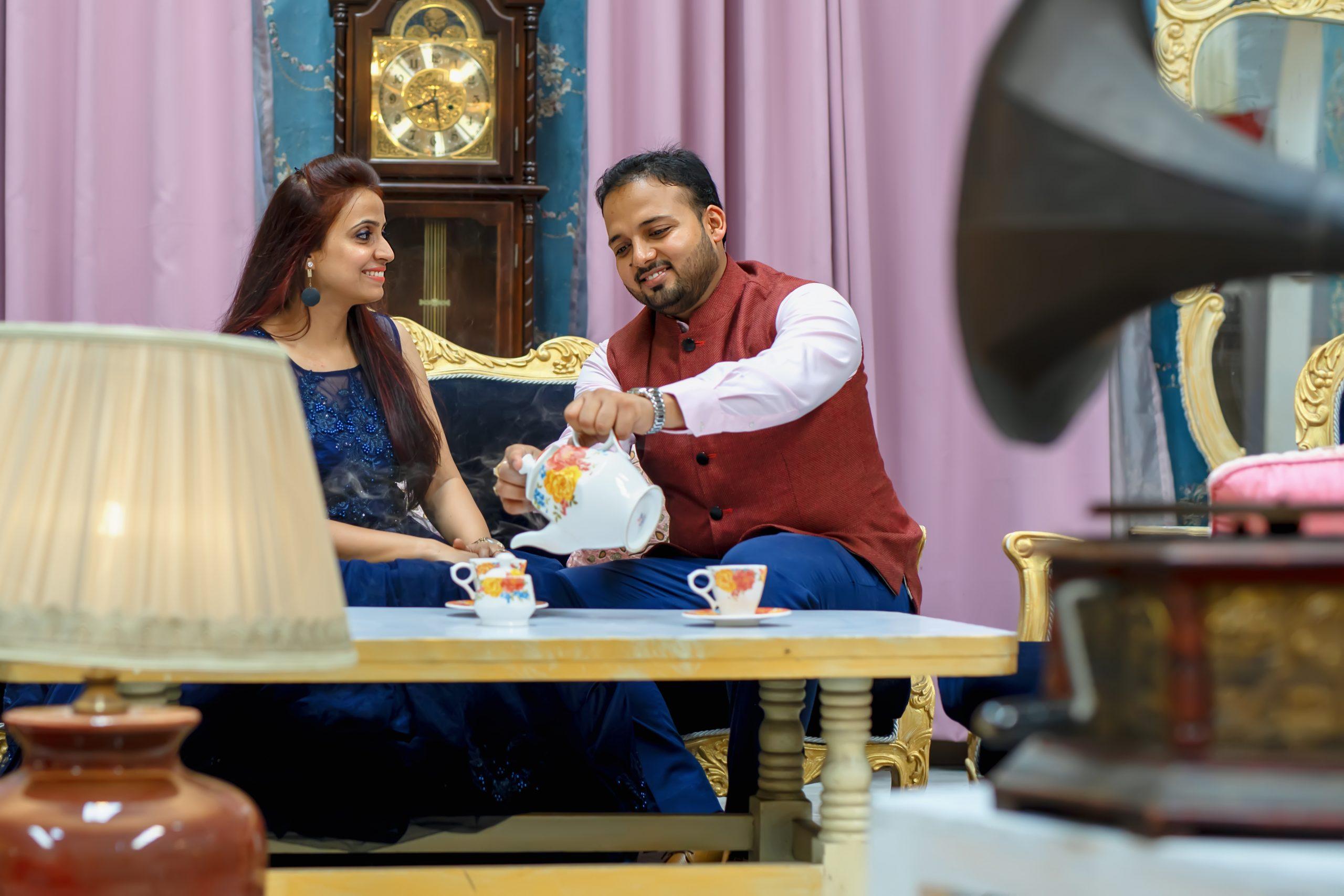A couple taking tea