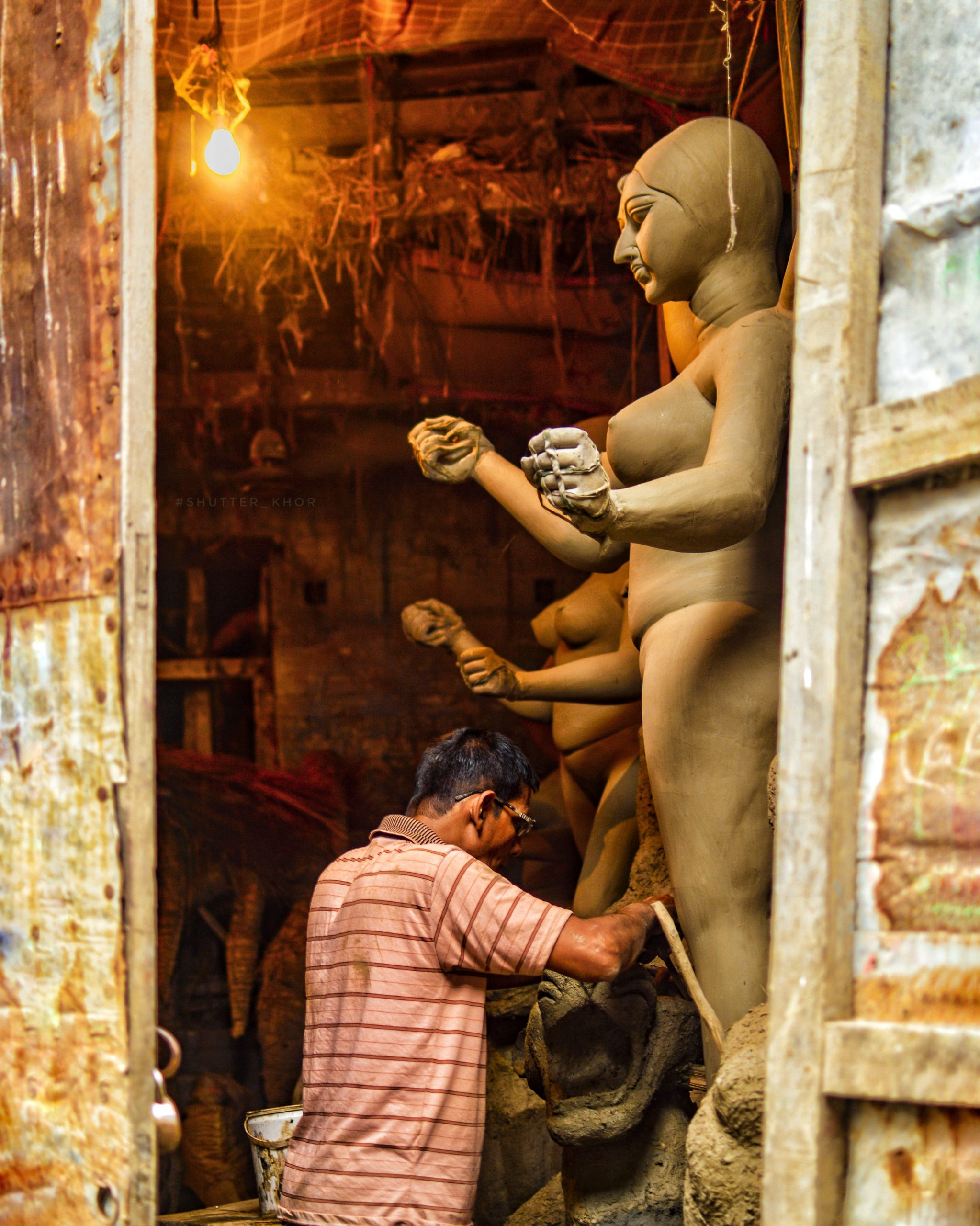 A craftsman working on statues