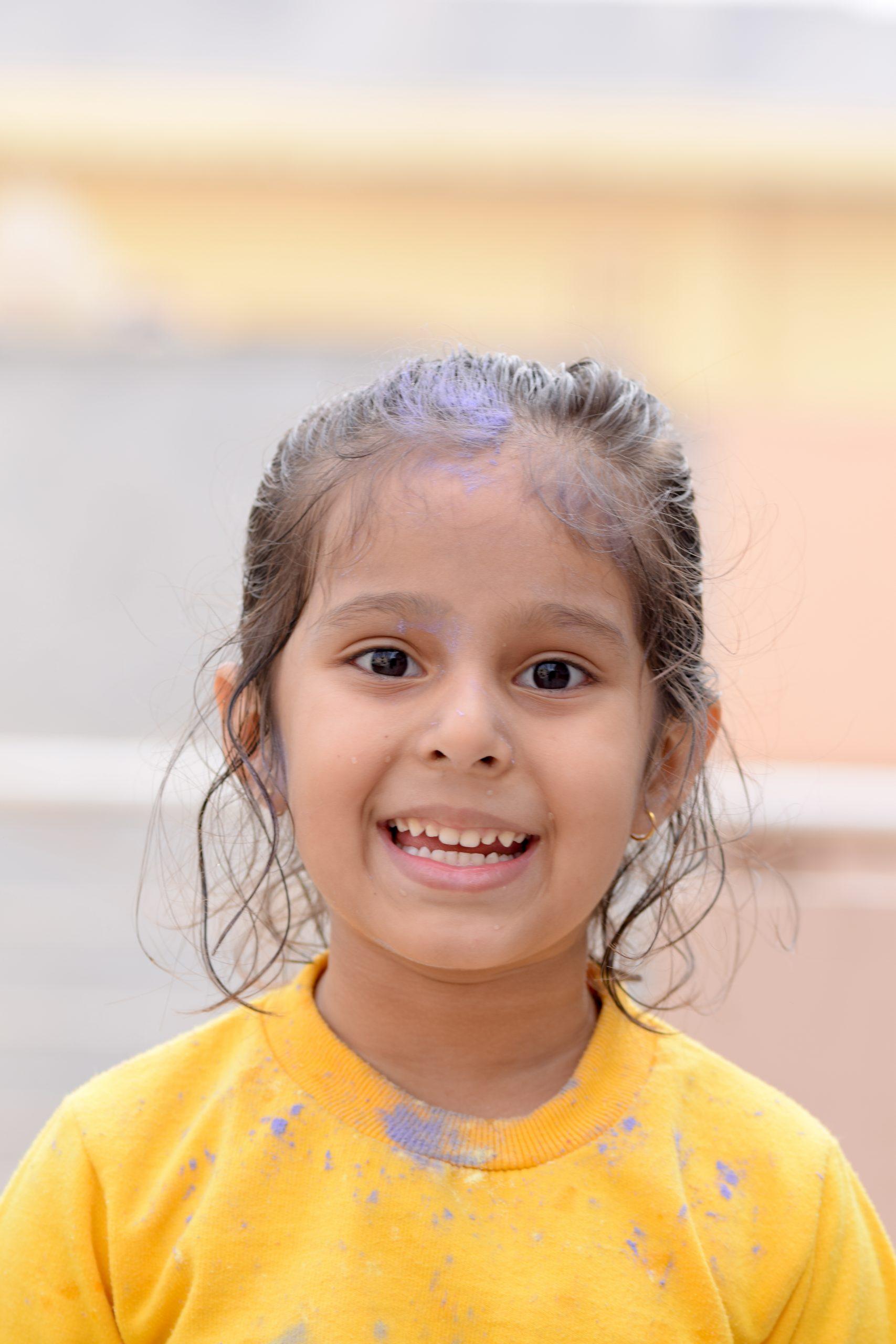 A cute little girl smiling