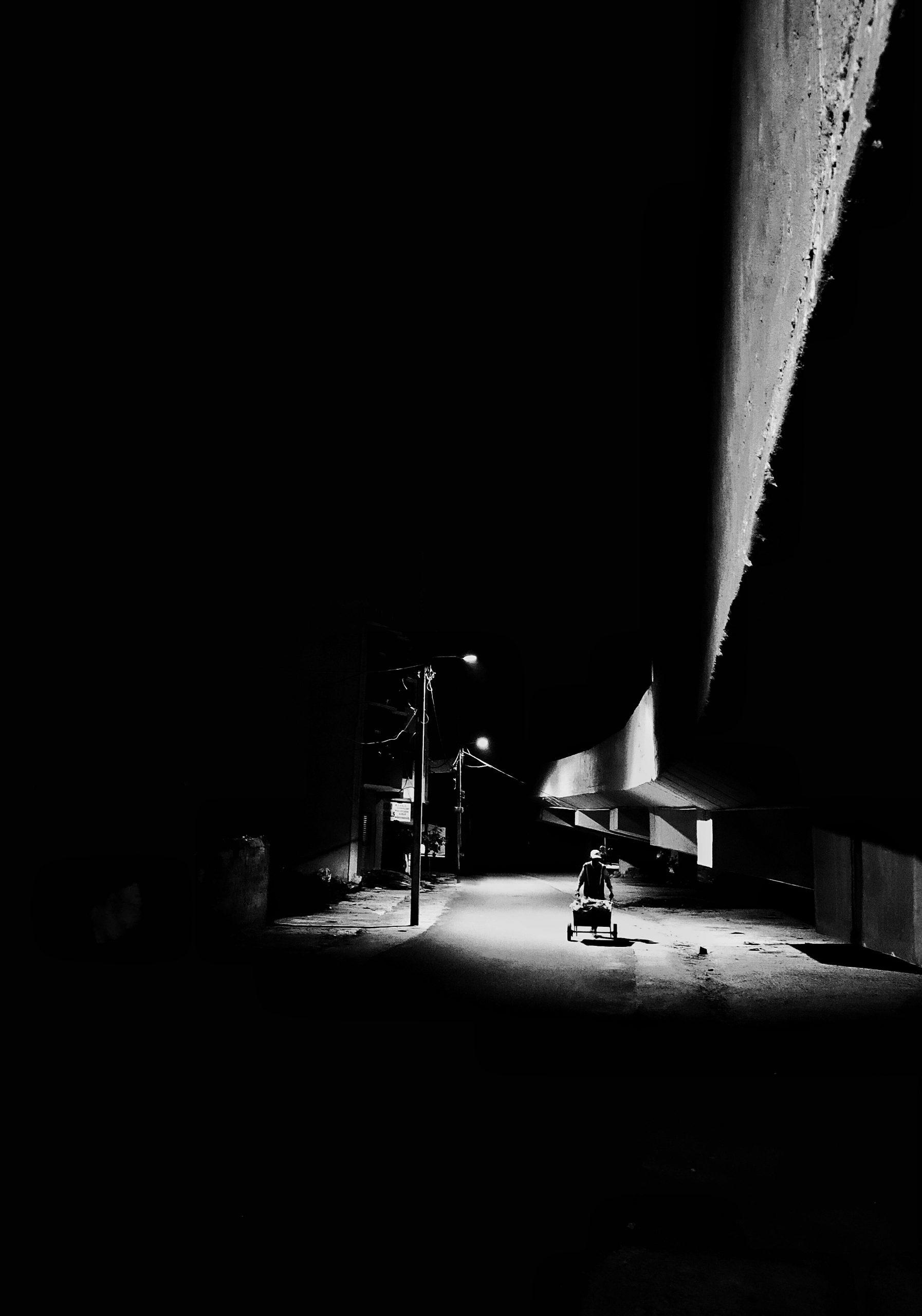 A cyclist going through dark place