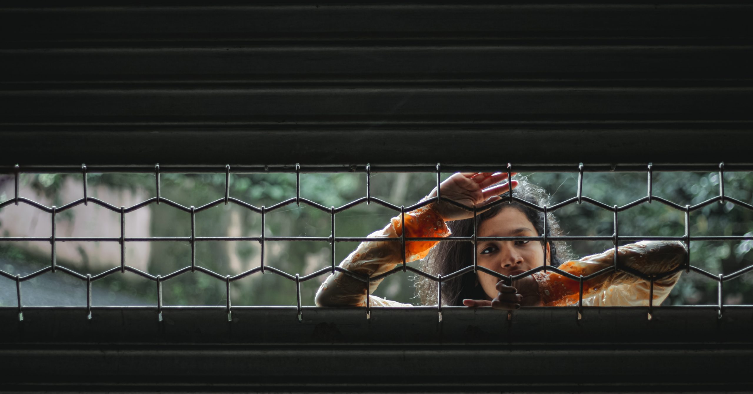 A girl behind a shutter
