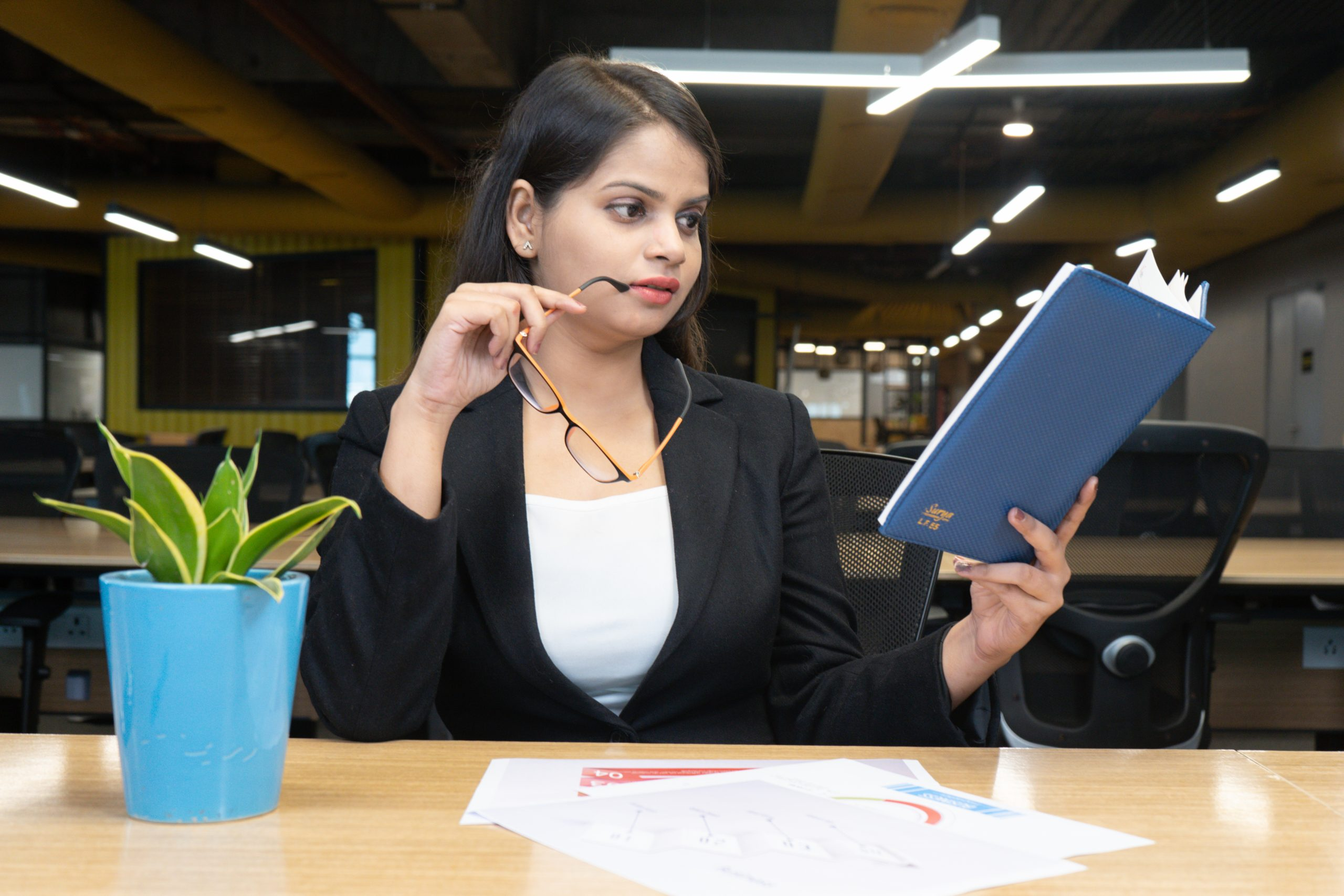 A girl checking her notebook in office