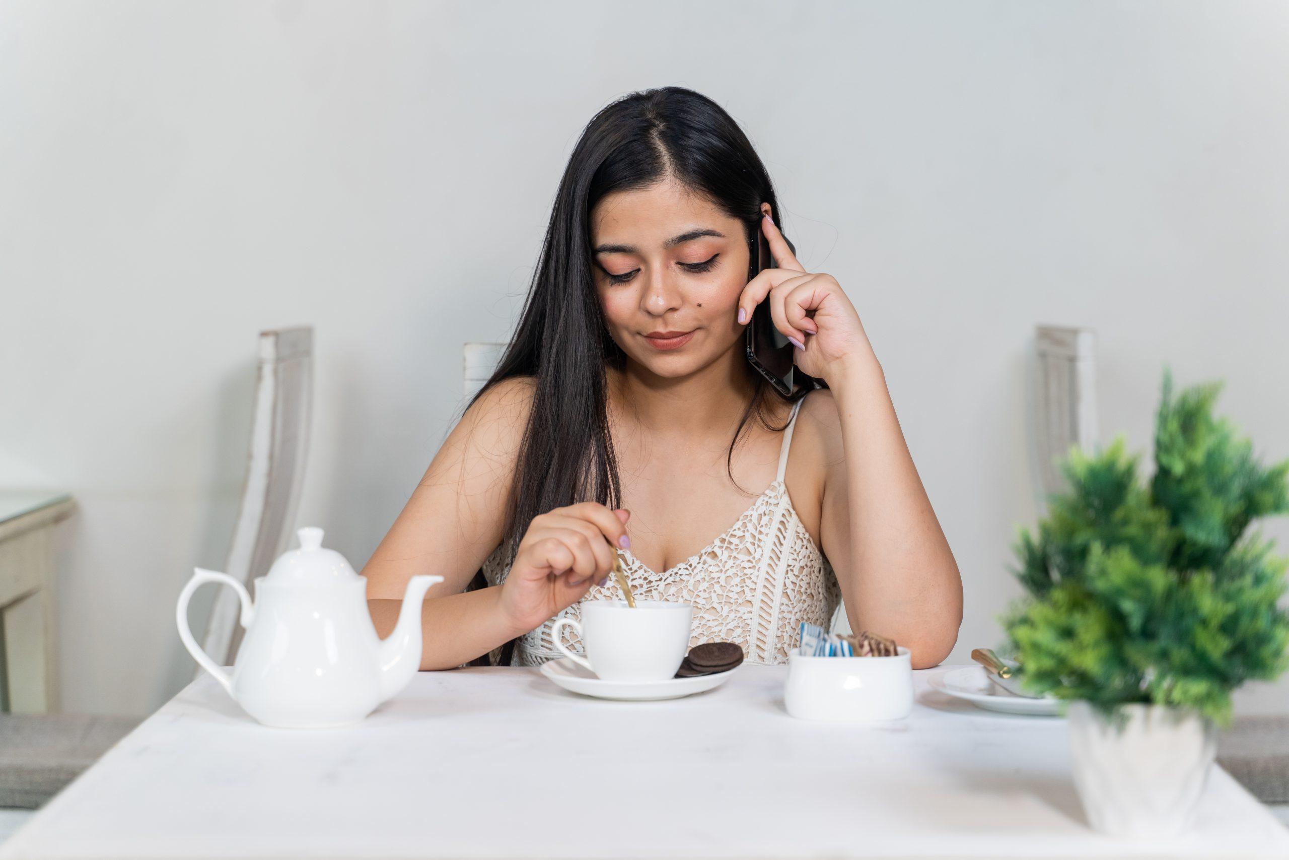 A girl in café taking tea