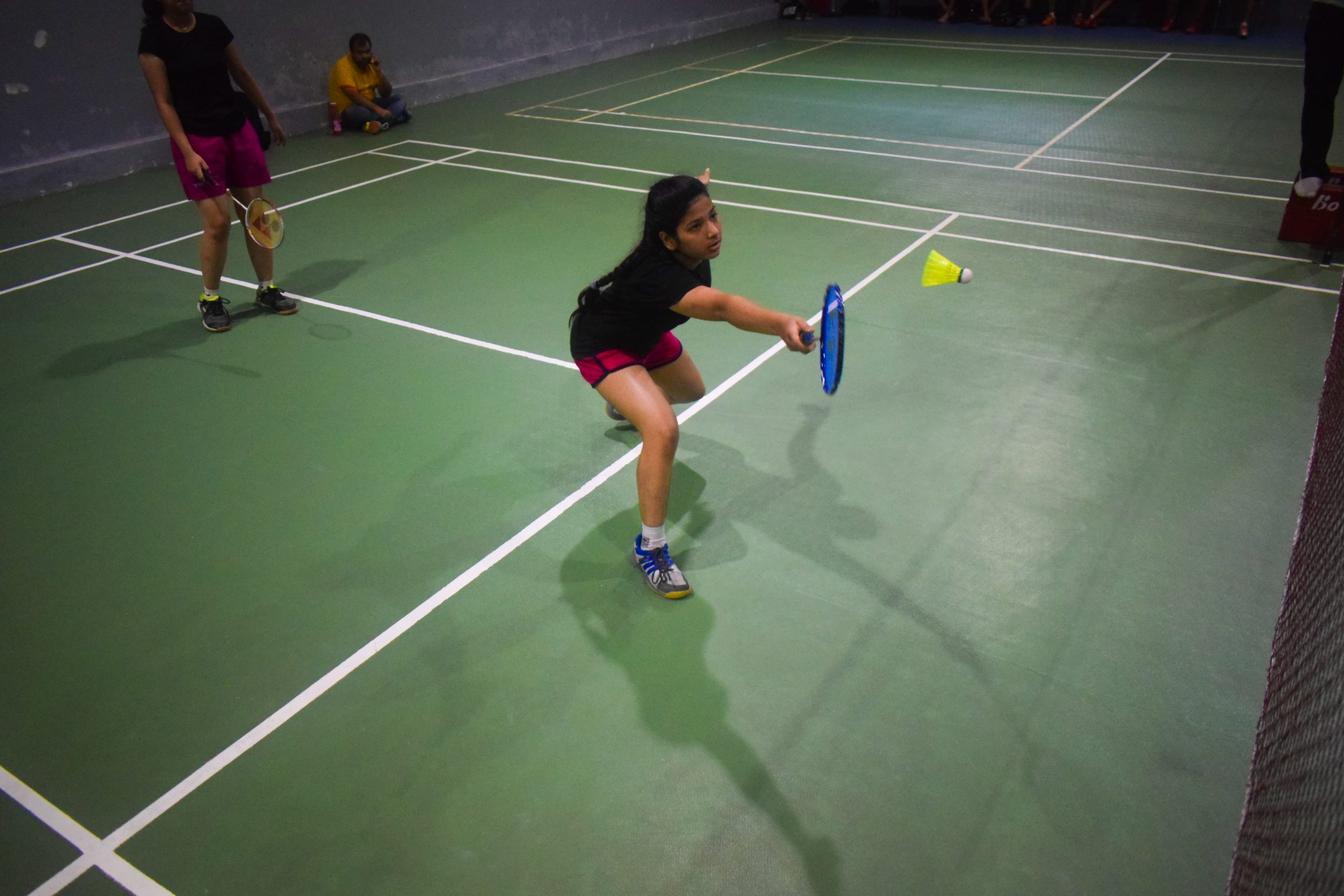 A girl playing badminton