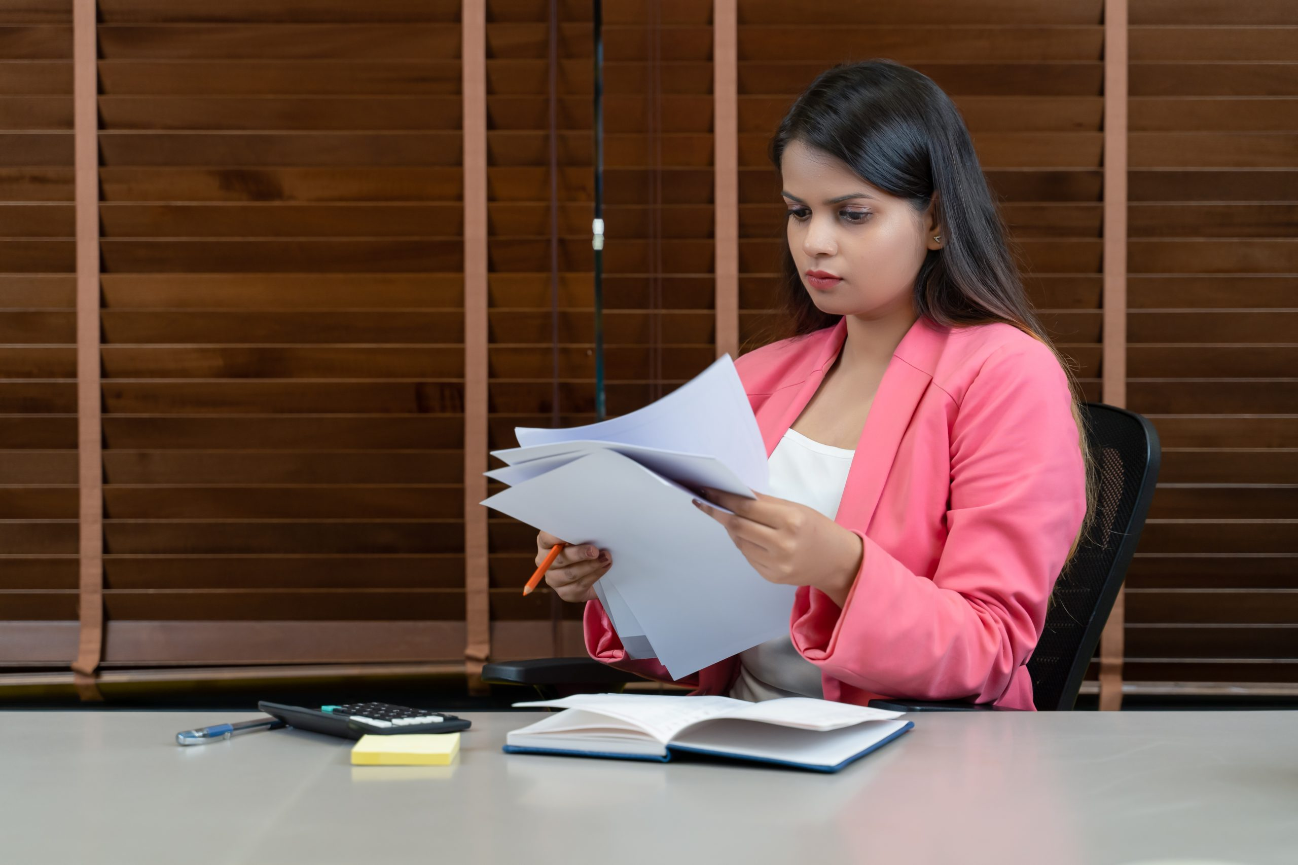 A girl seeing the business reports
