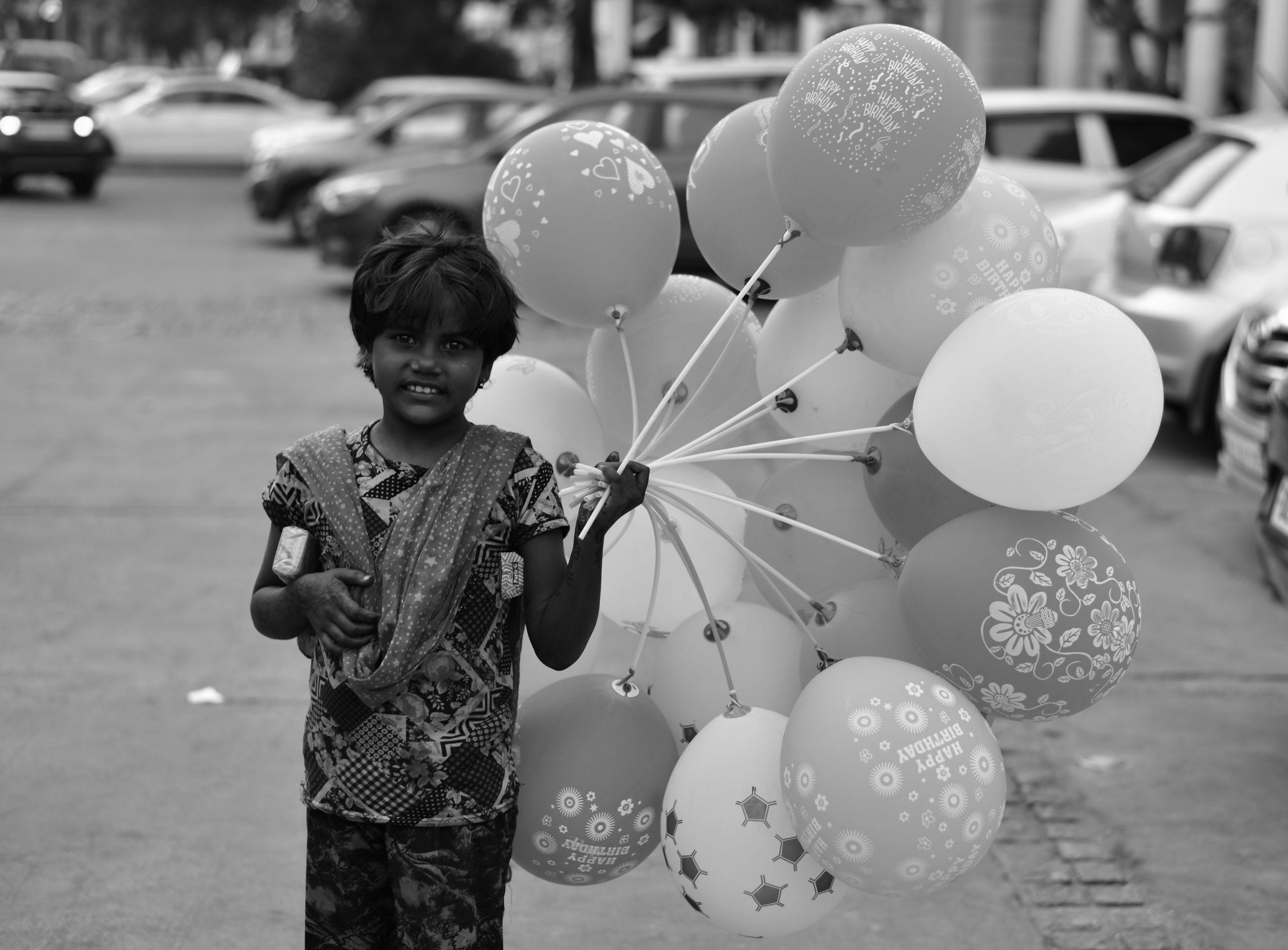 kid selling balloons