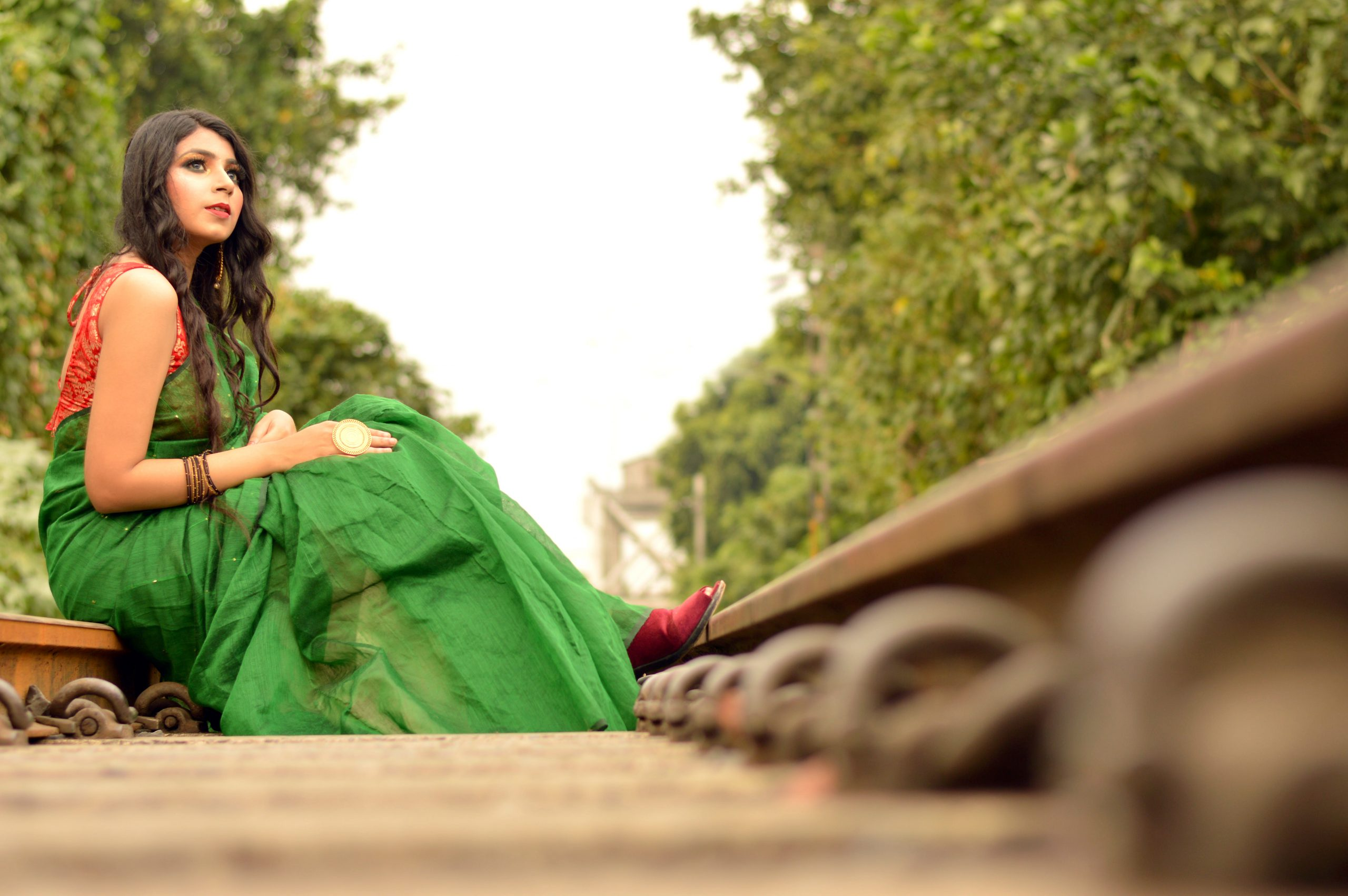 A girl sitting at railway track