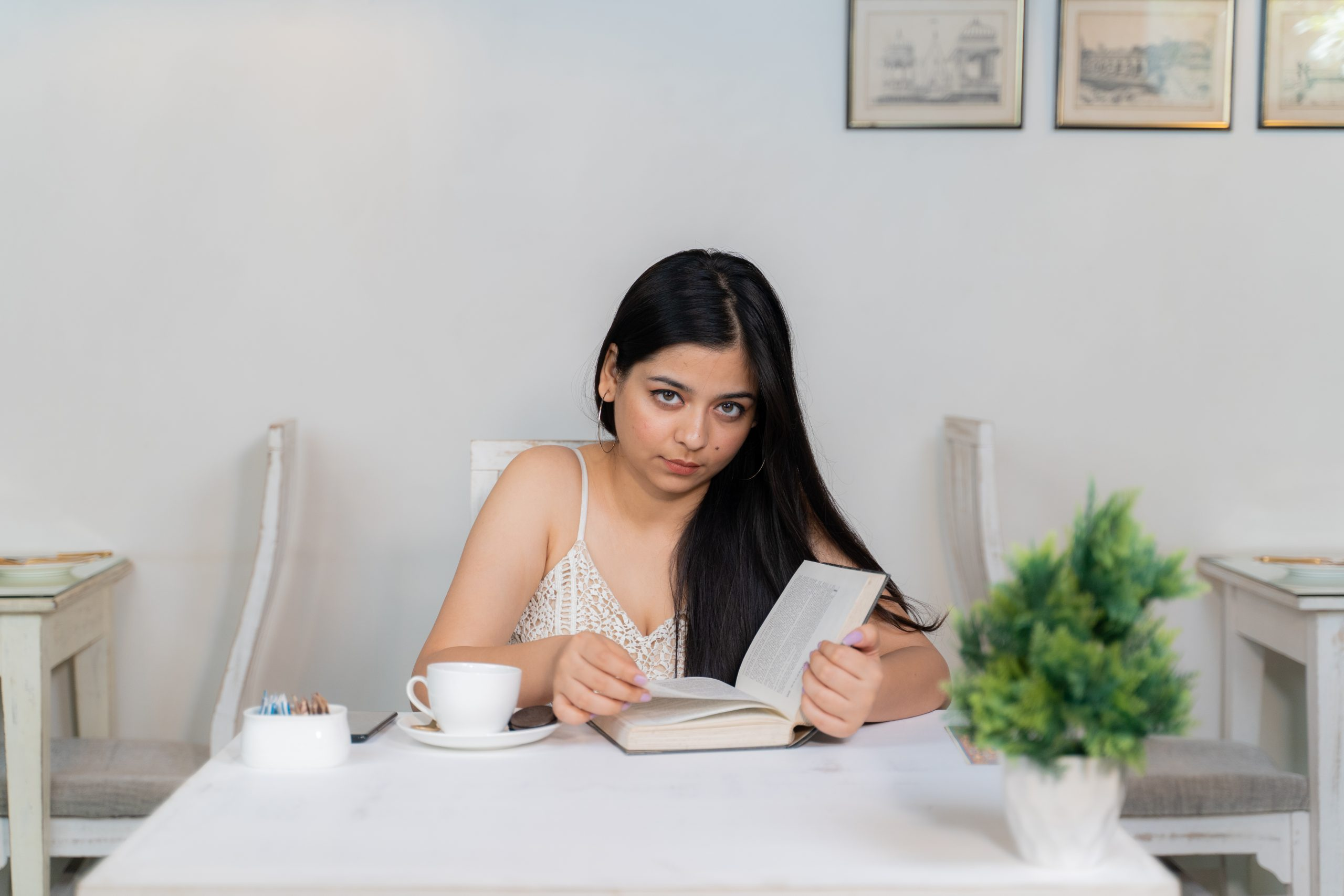 A girl staring while reading