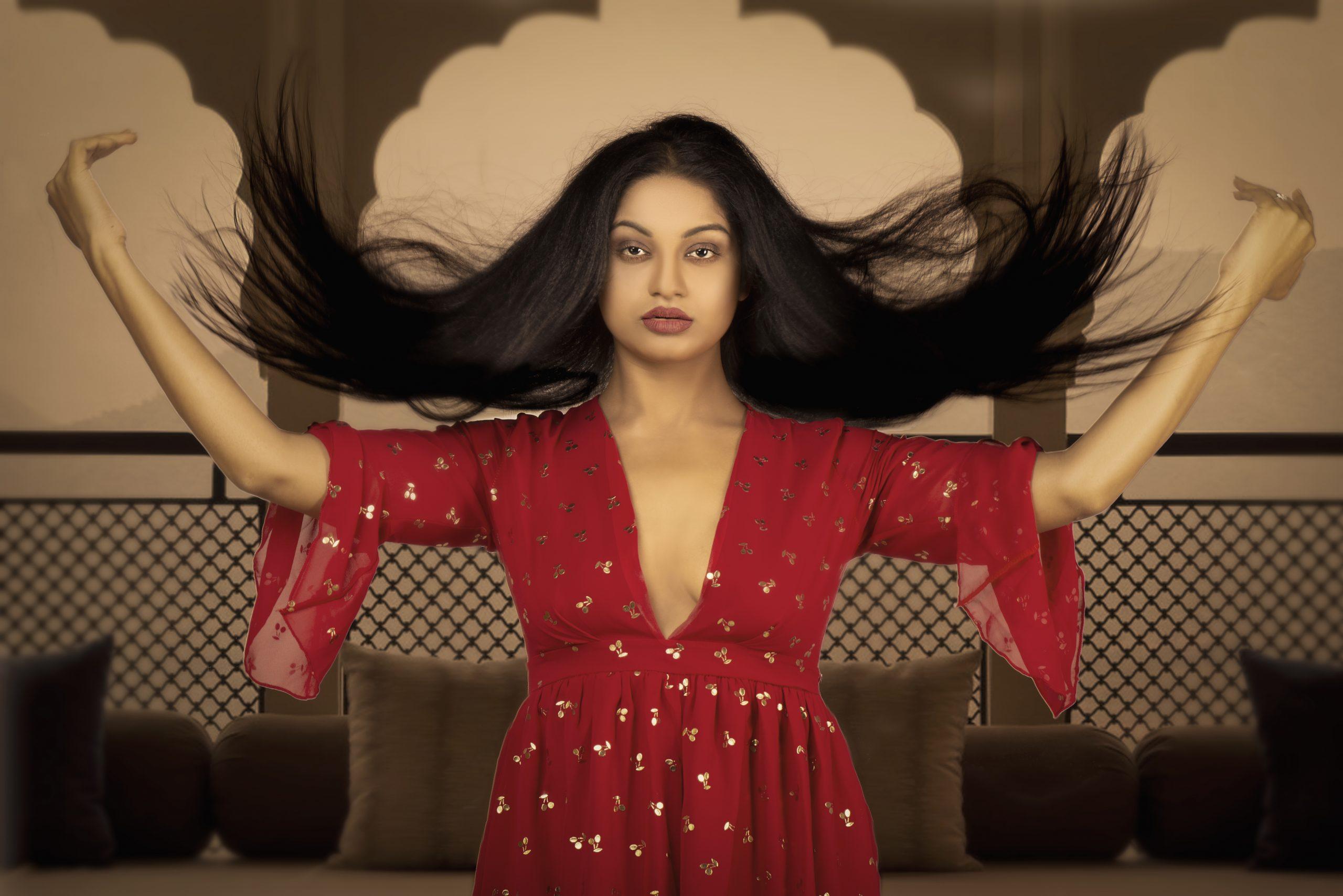 A girl swirling her hair