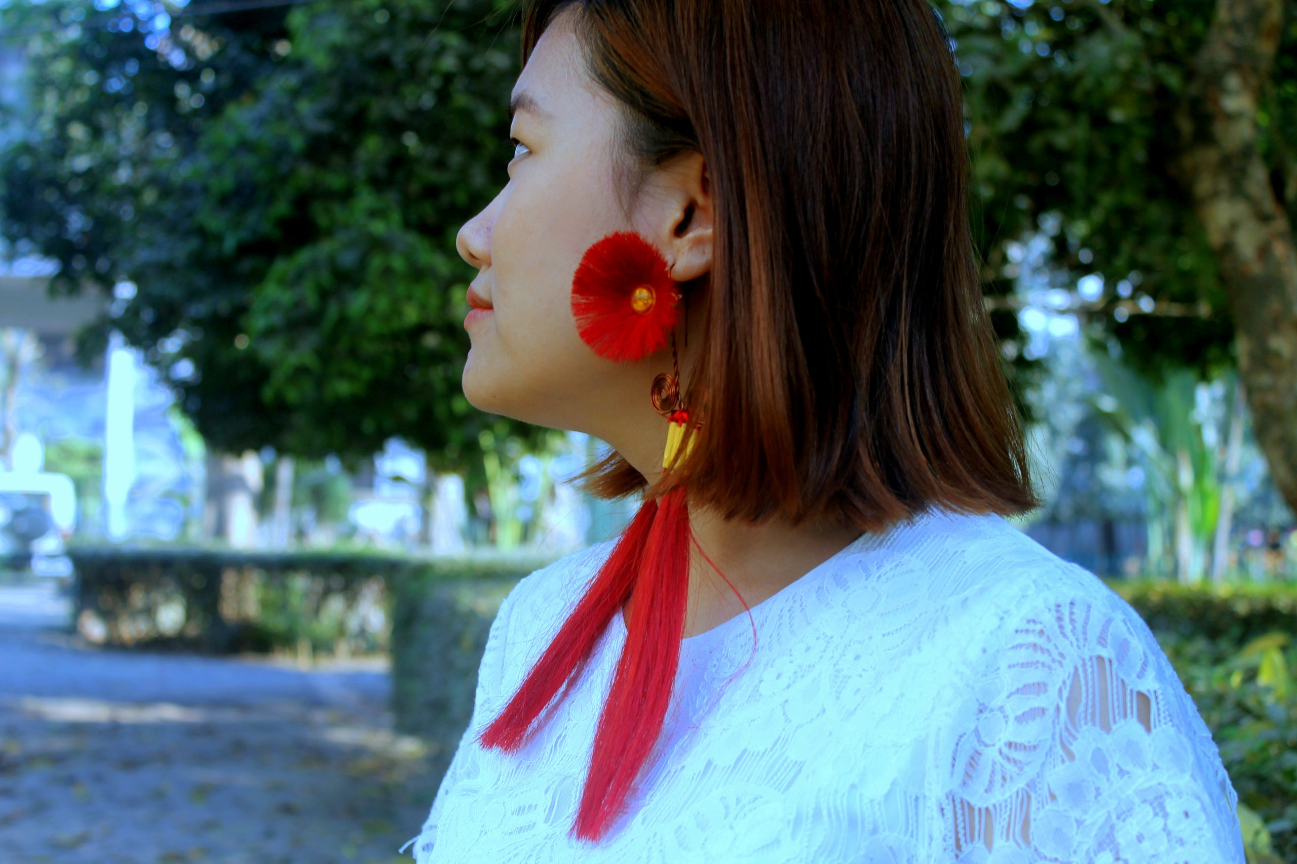 A girl with floral earrings