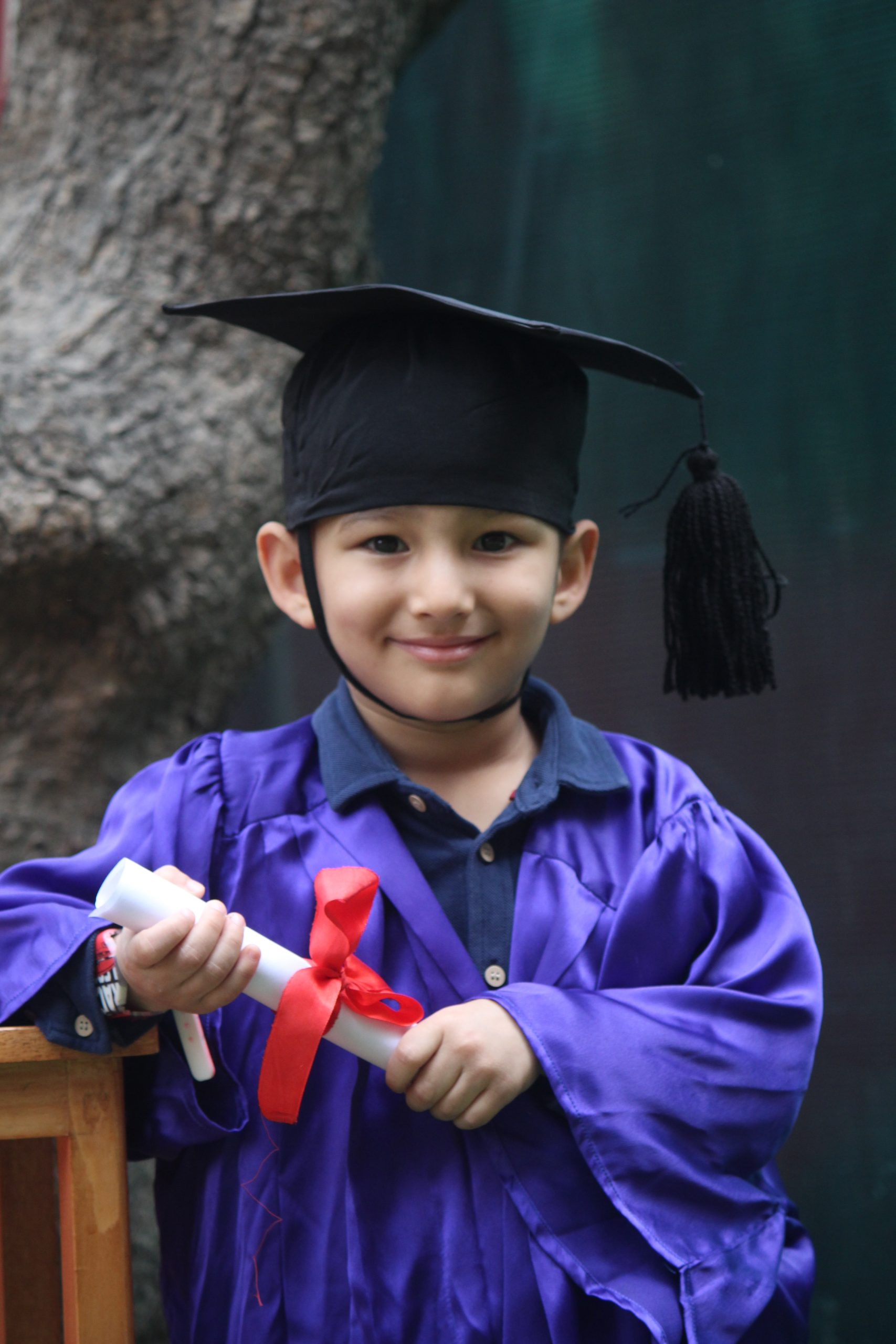 A kid in graduation gown