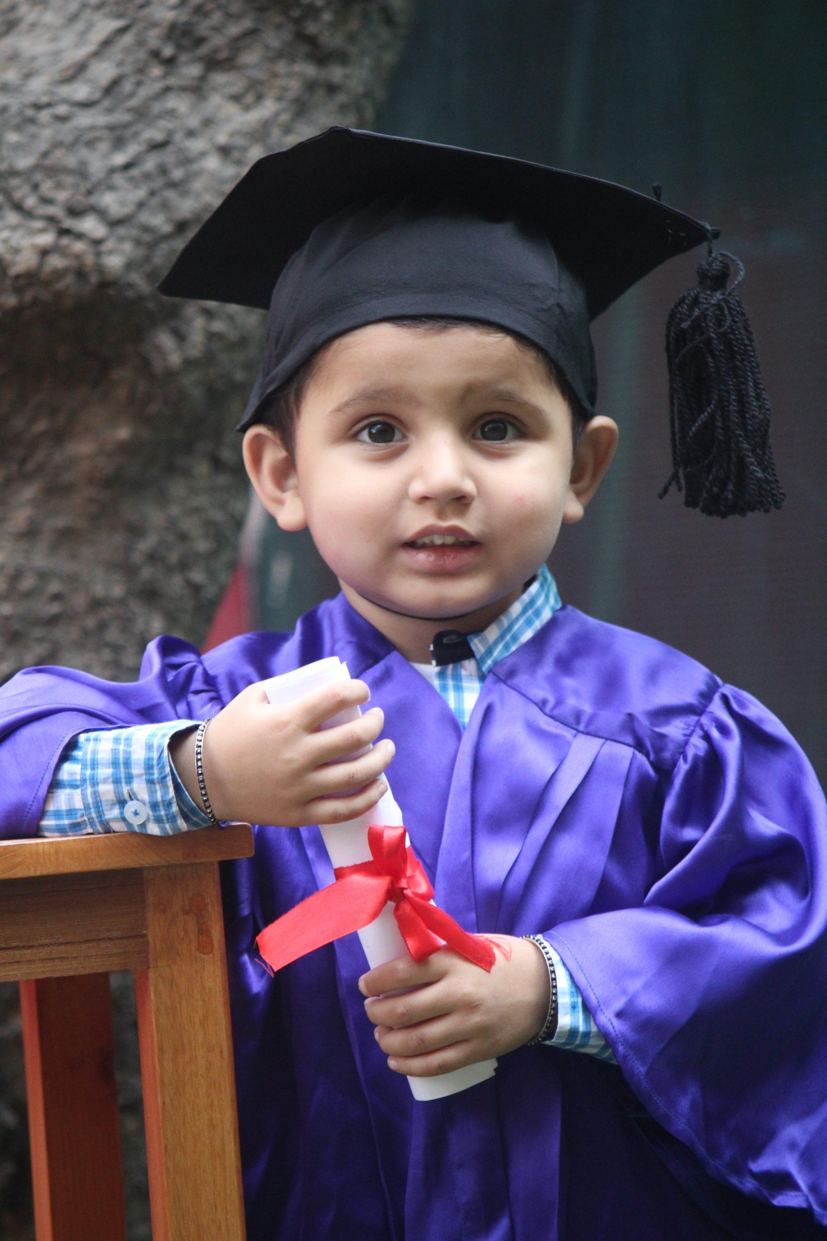 A kid wore graduation day dress