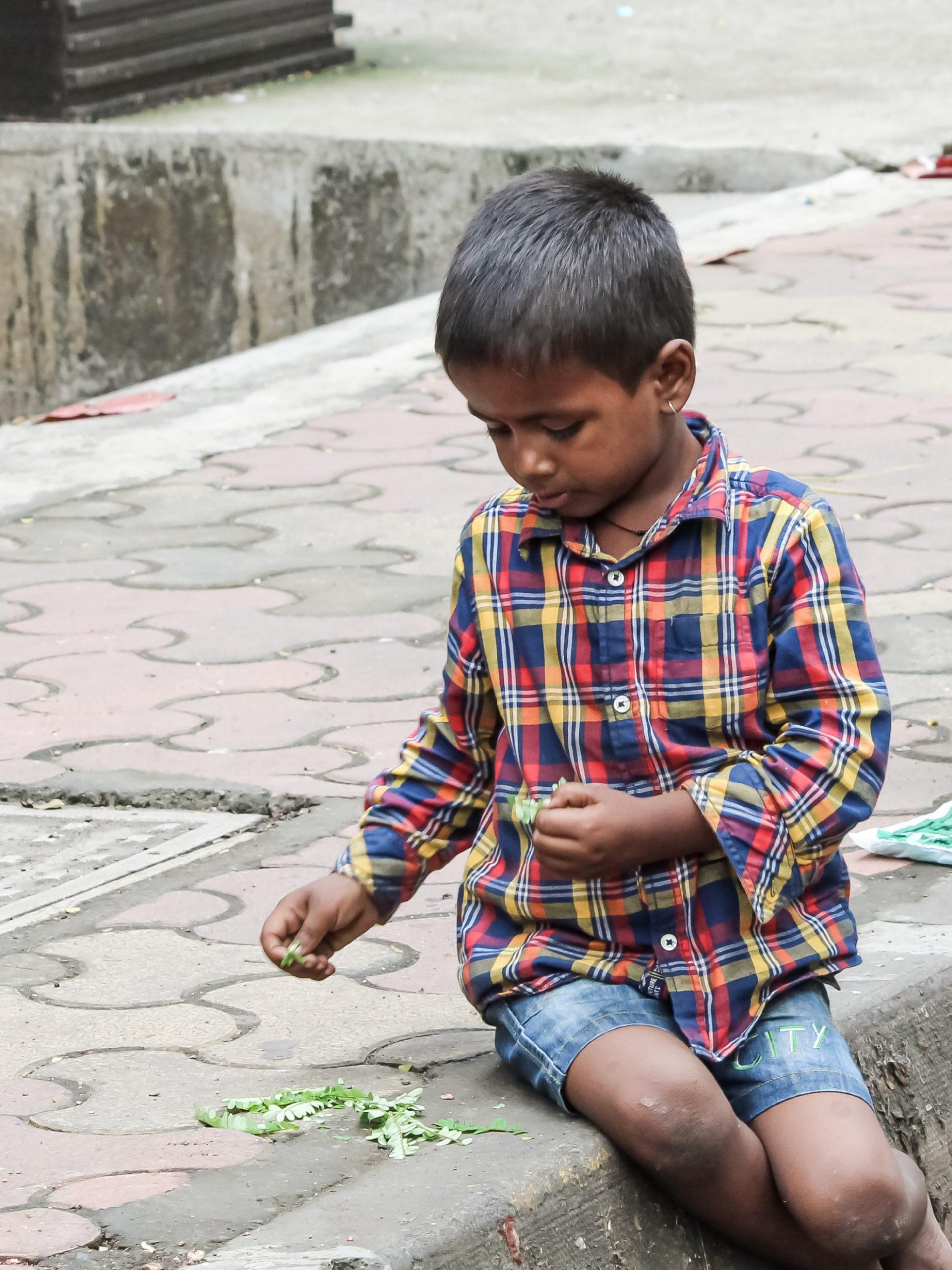 A little boy beside a road