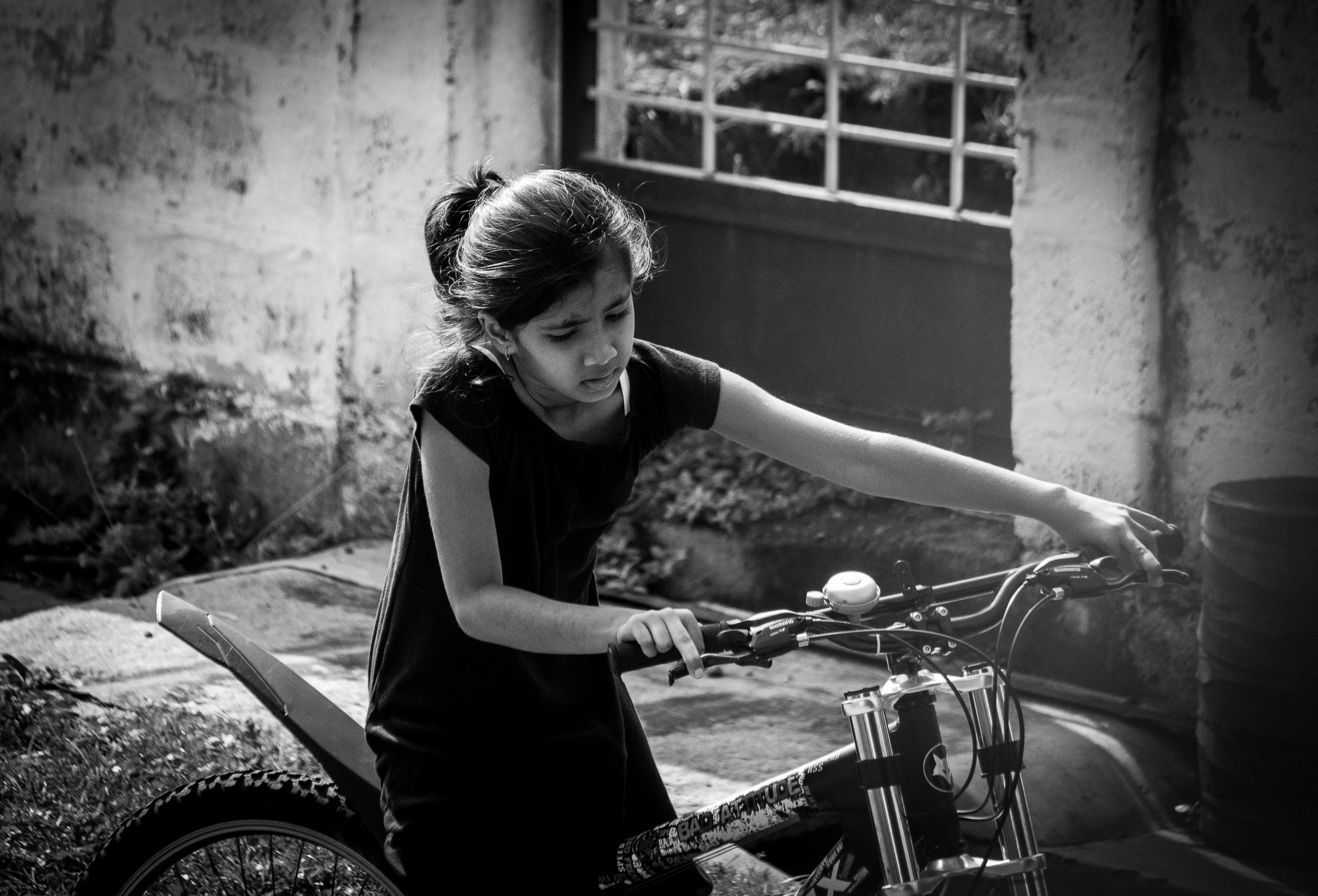 A little girl on a bicycle