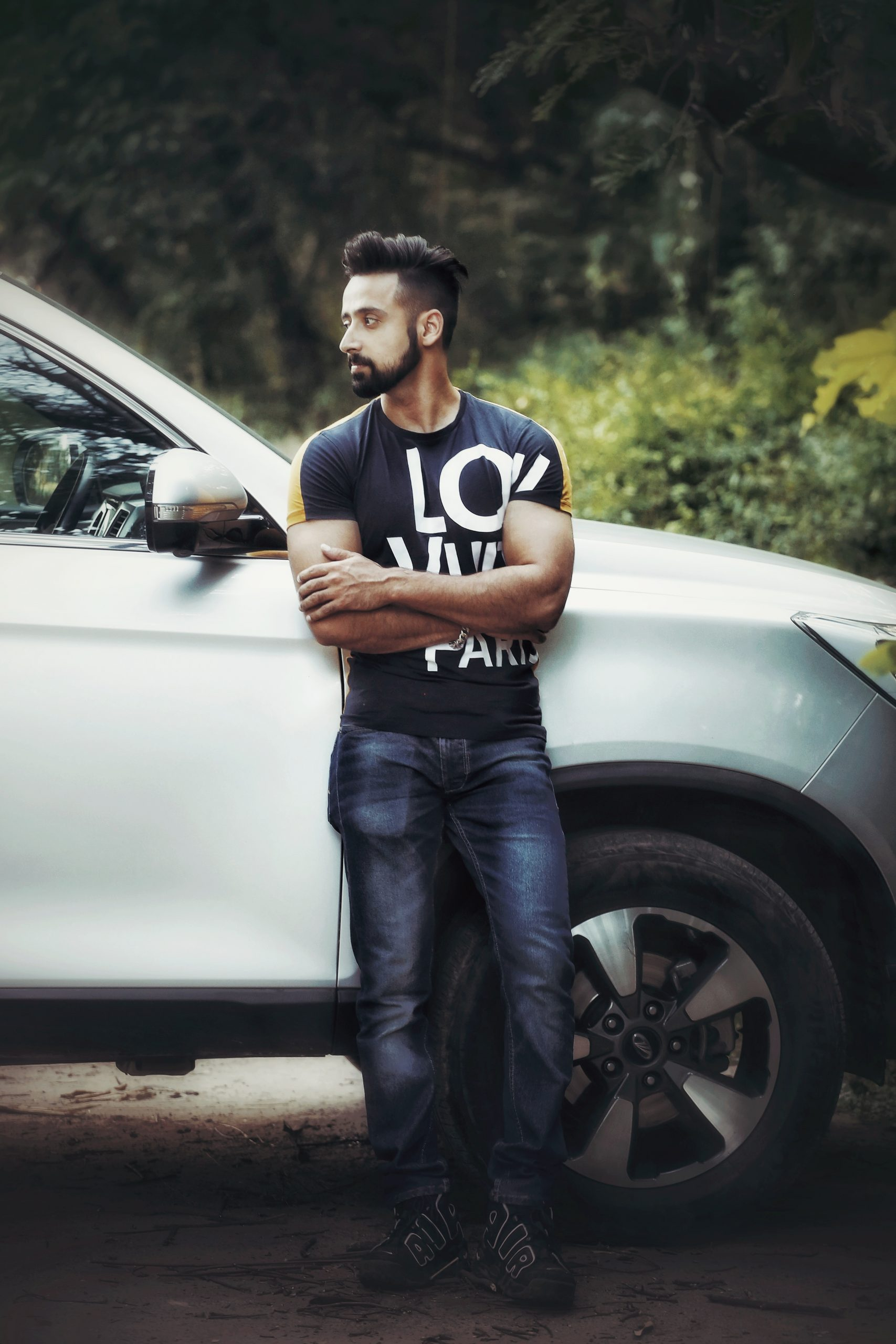 A man leaning on his car
