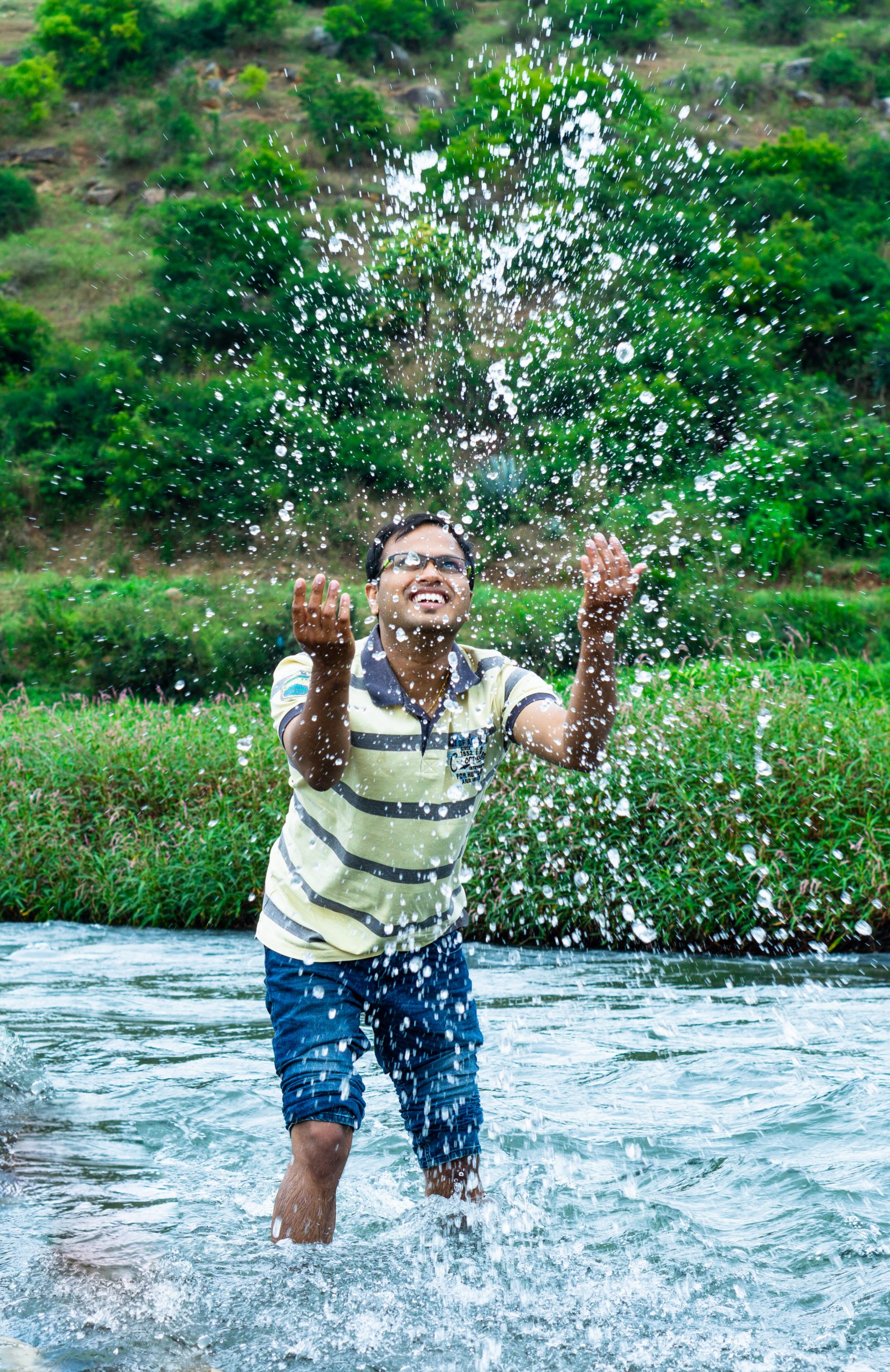 A man playing with water.