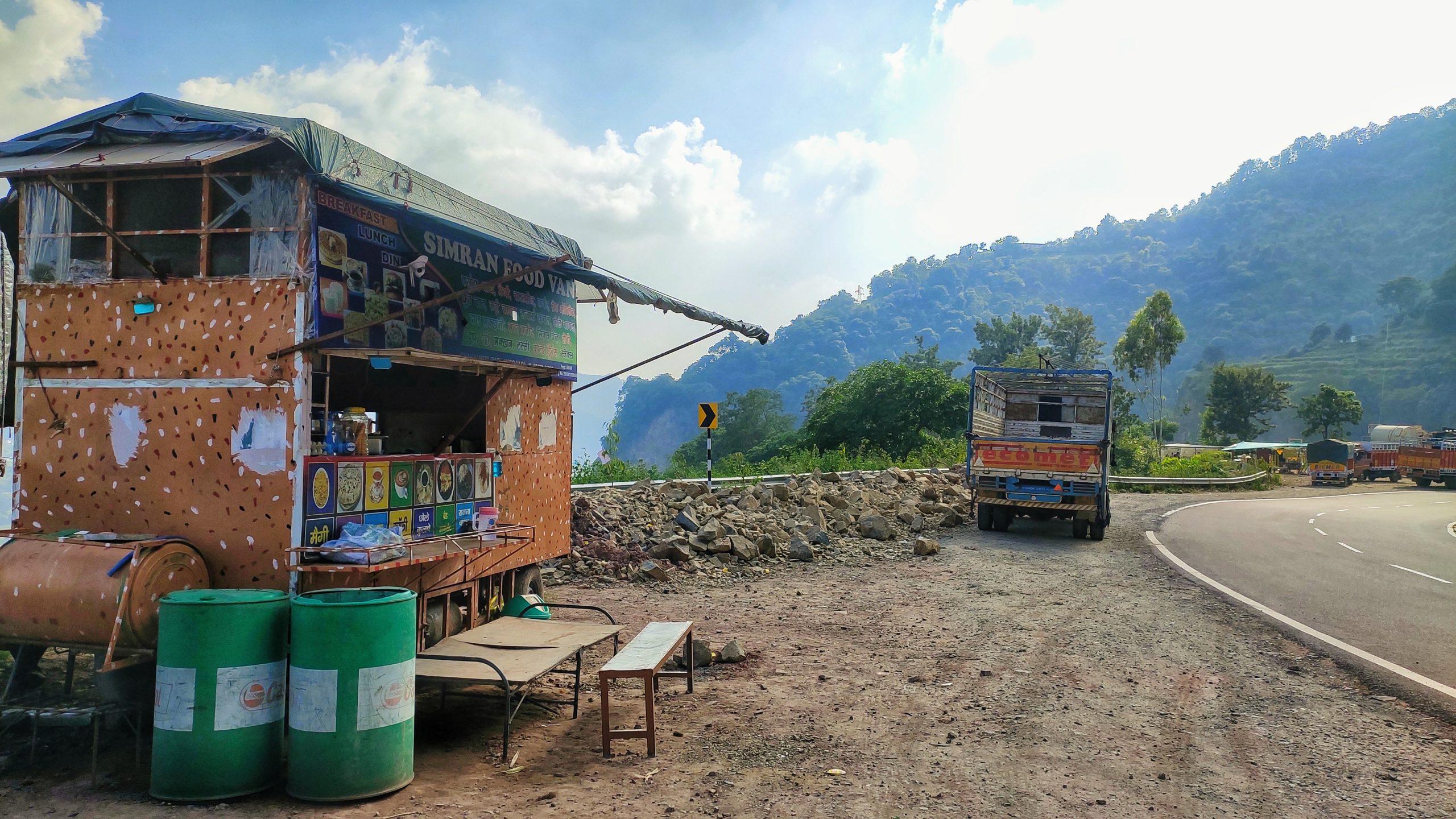 A mini food hut beside a road