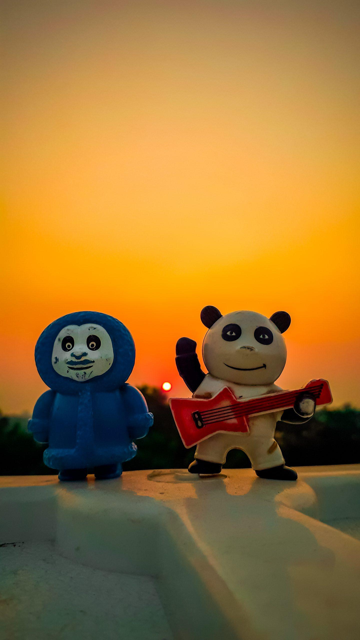 A pair of Panda toys