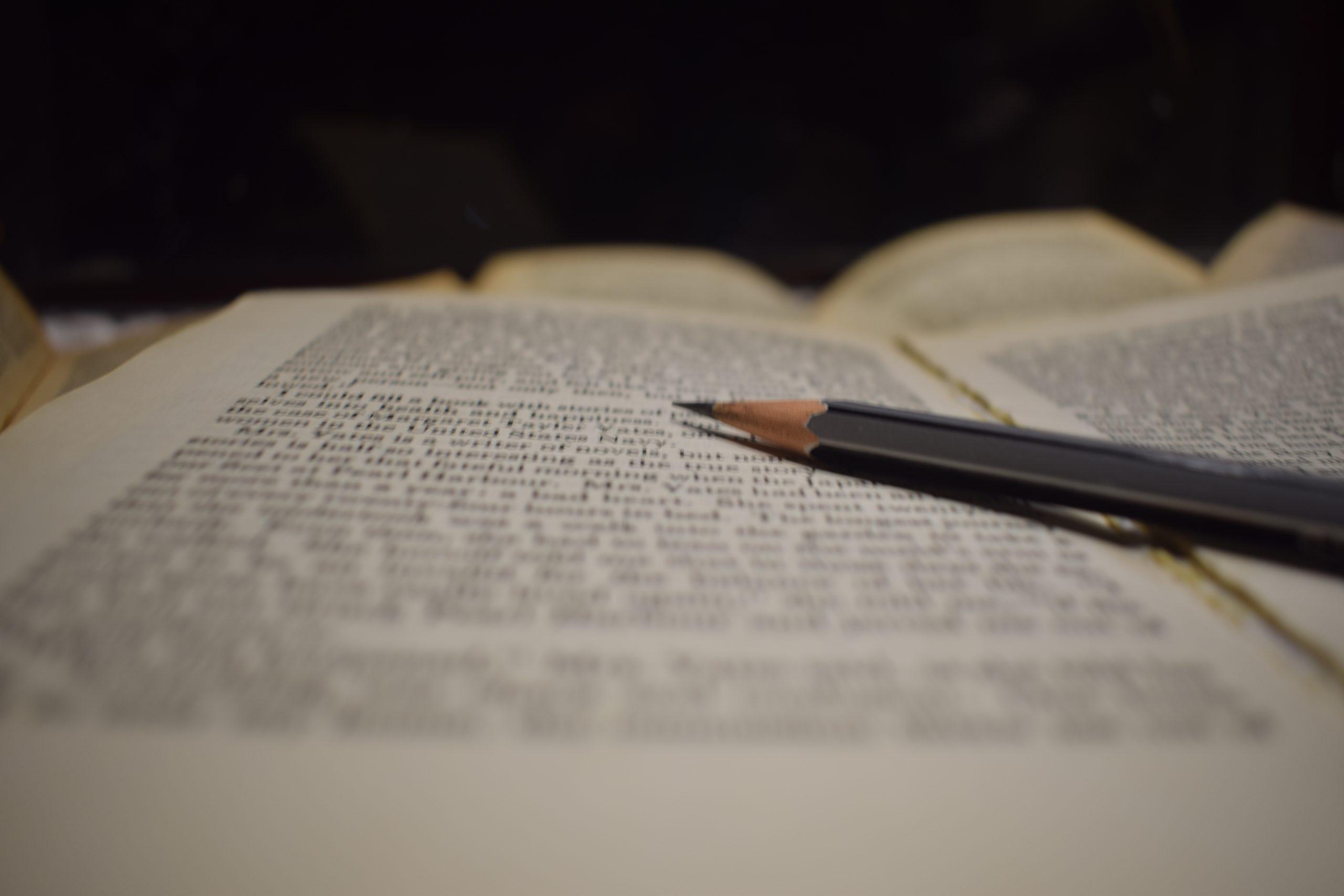 A pencil on a book