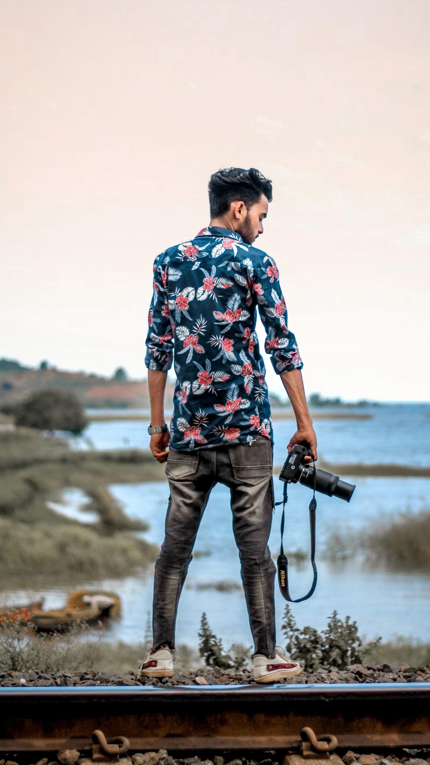A photographer on a railway track