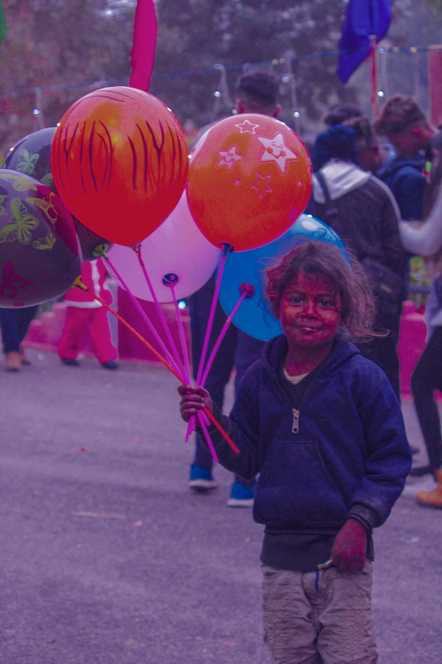 A poor child selling ballons