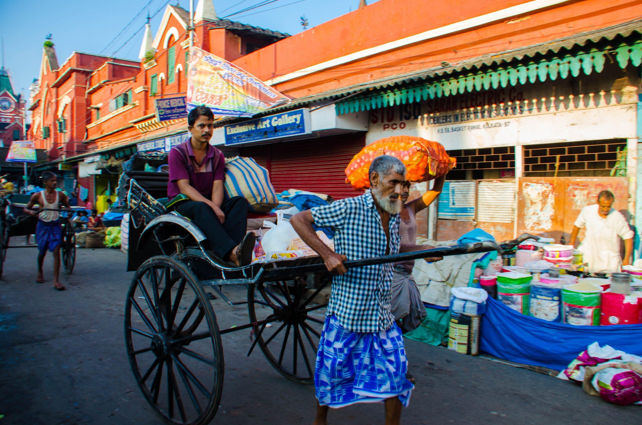 A pulled rickshaw in a market