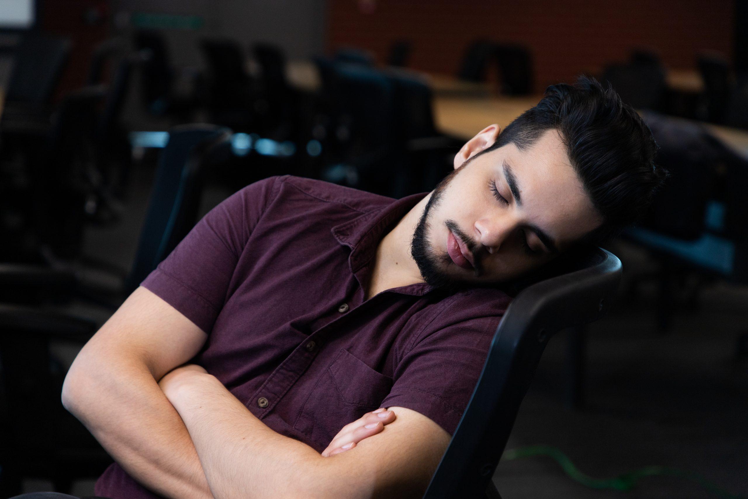 man sleeping on a chair