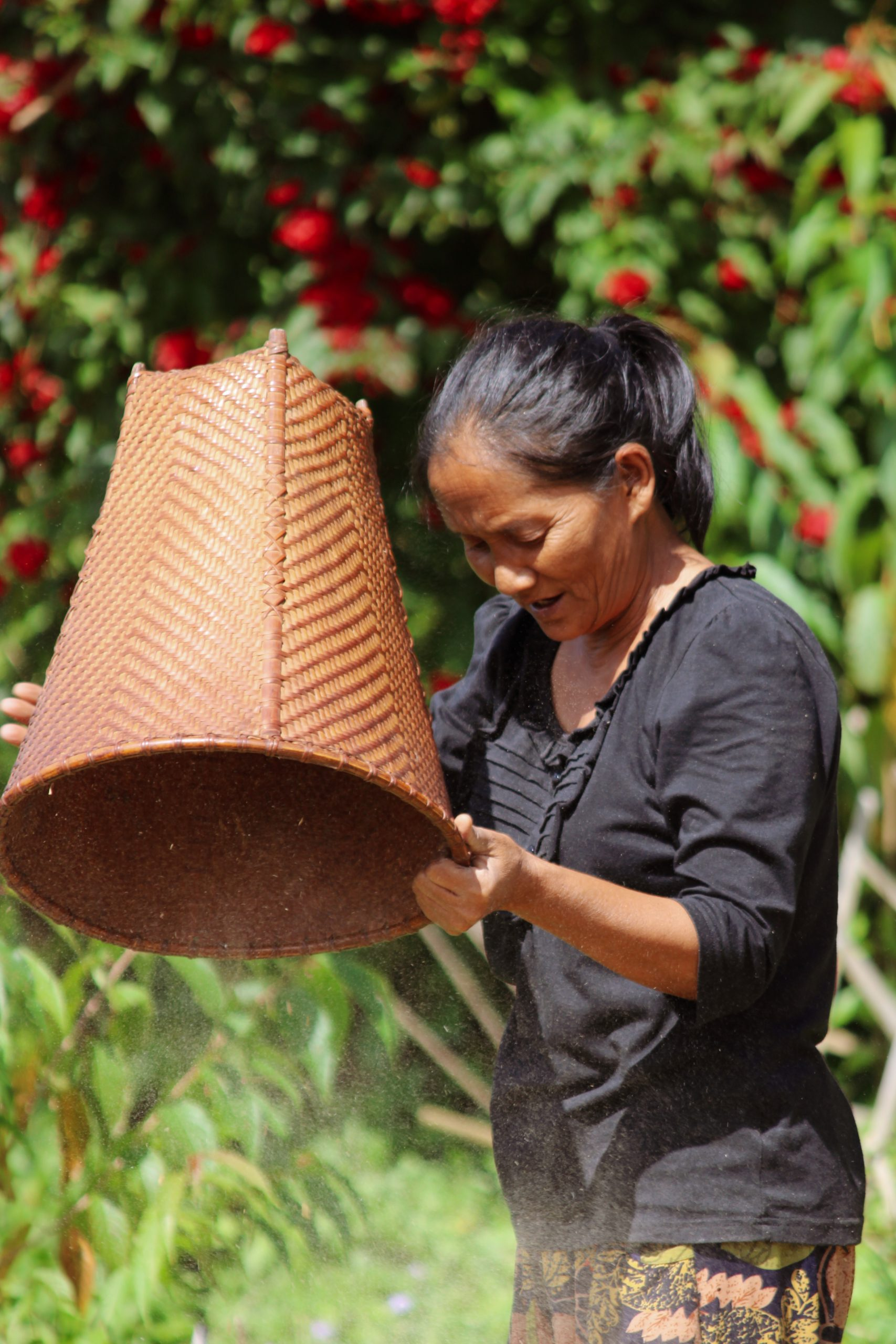 A woman holding bamboo basket