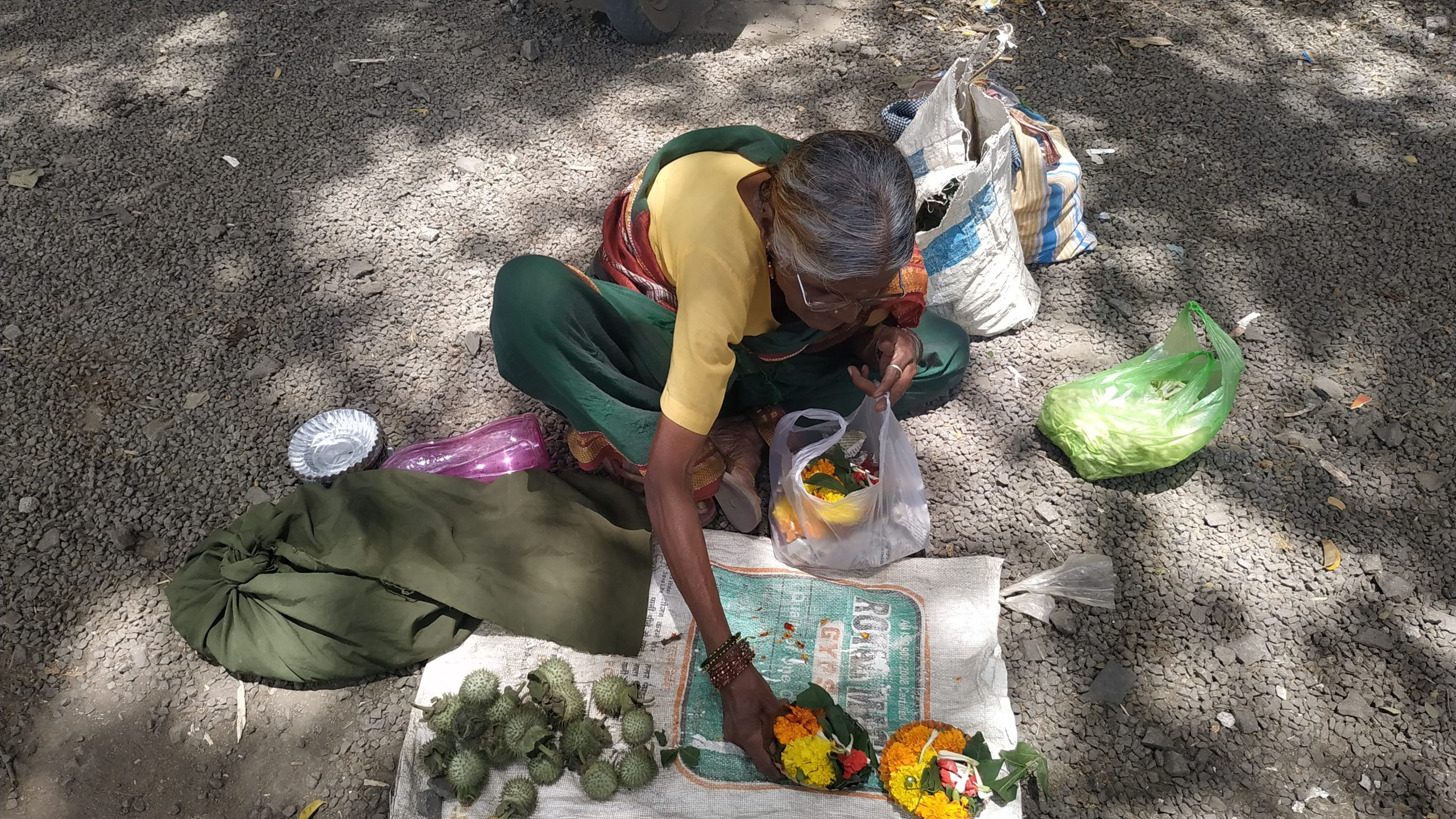 A woman selling things outside a temple