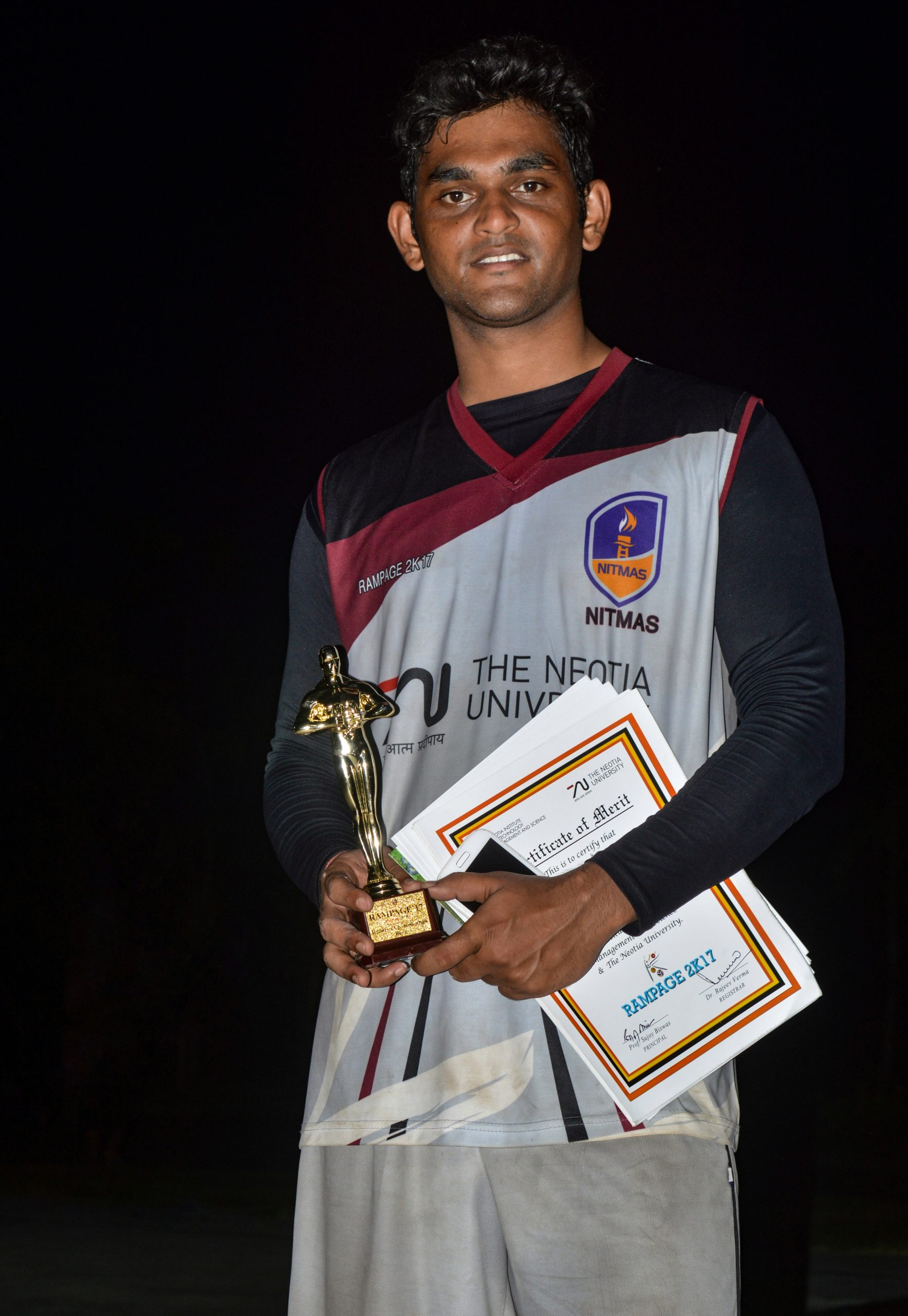 man with certificate and trophy