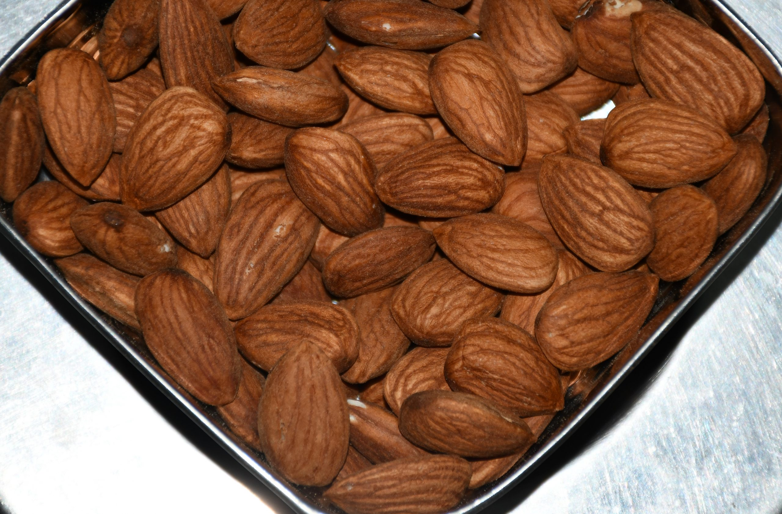 A bowl full of almonds
