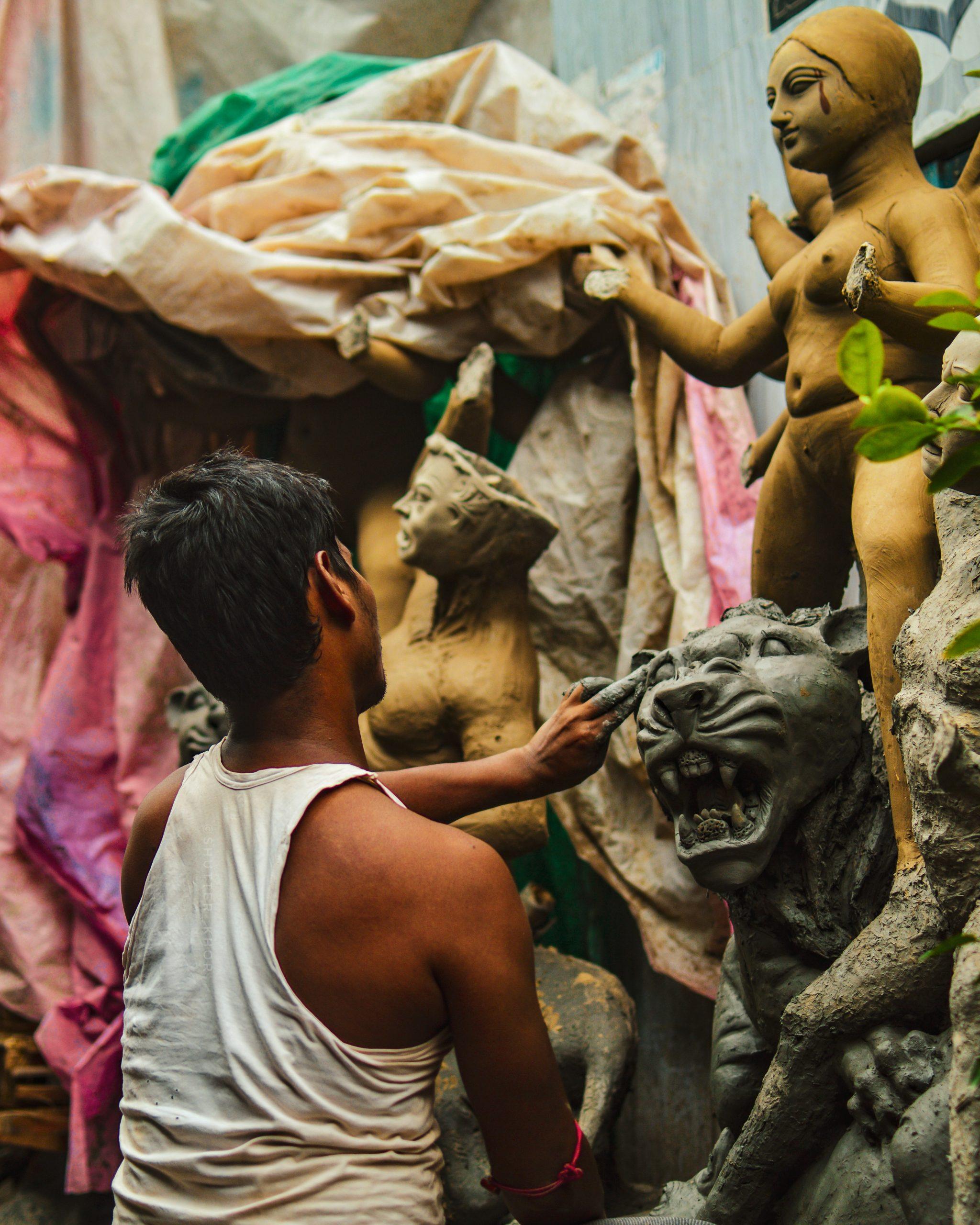 An artist making statues