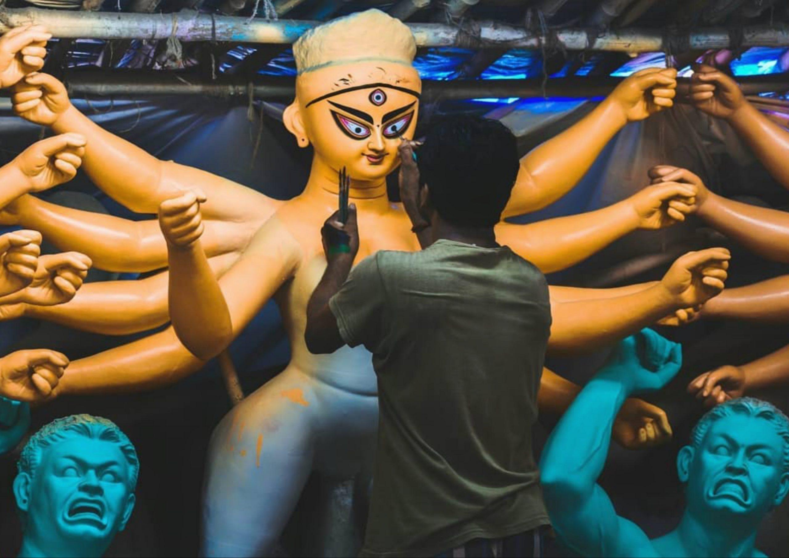 An artist painting Goddess statue