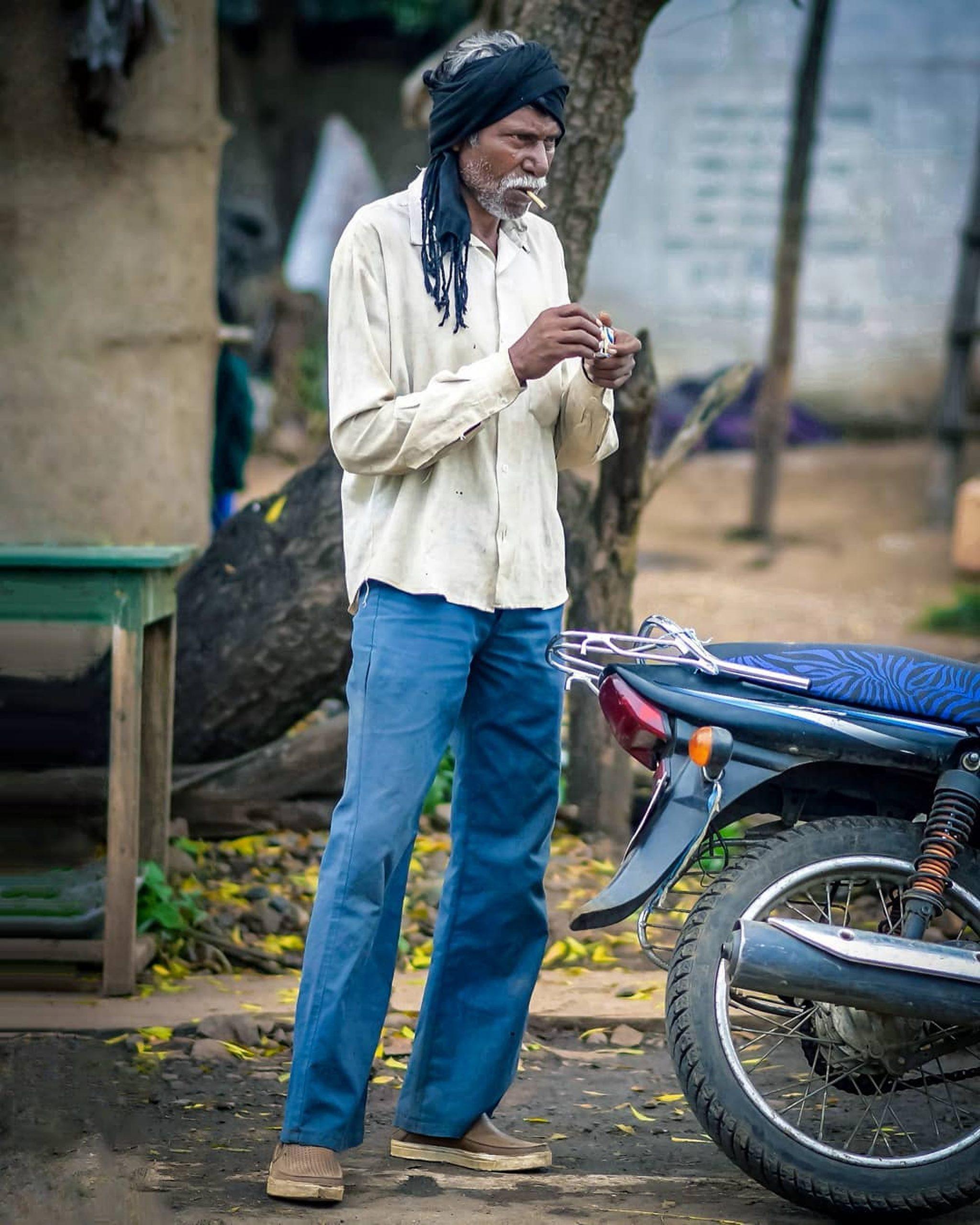 An old Man smoking cigarettes