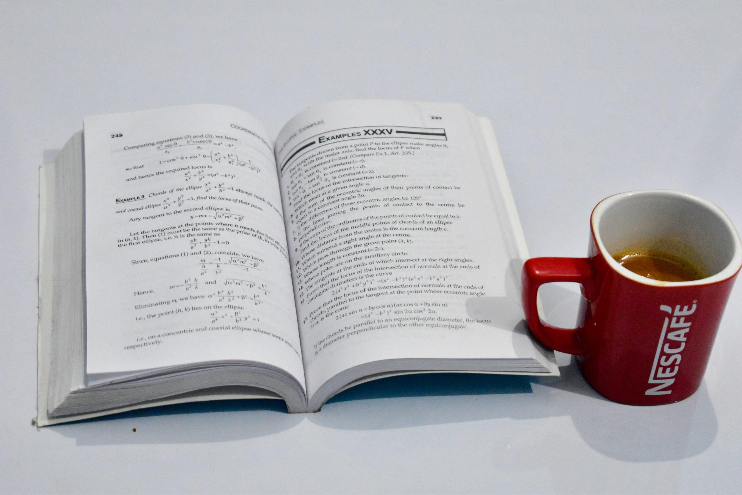 An open book and coffee mug